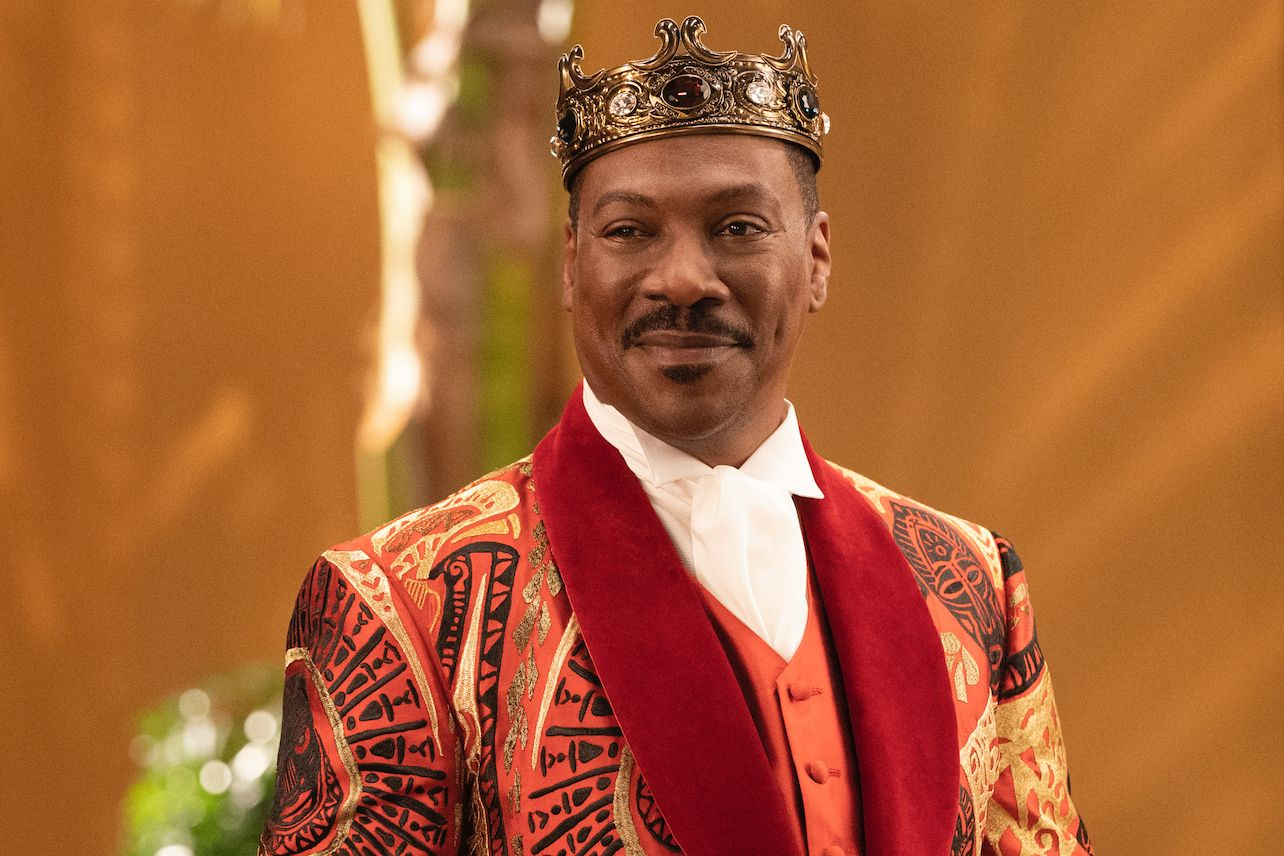 Eddie Murphy wearing royal robes and a crown.