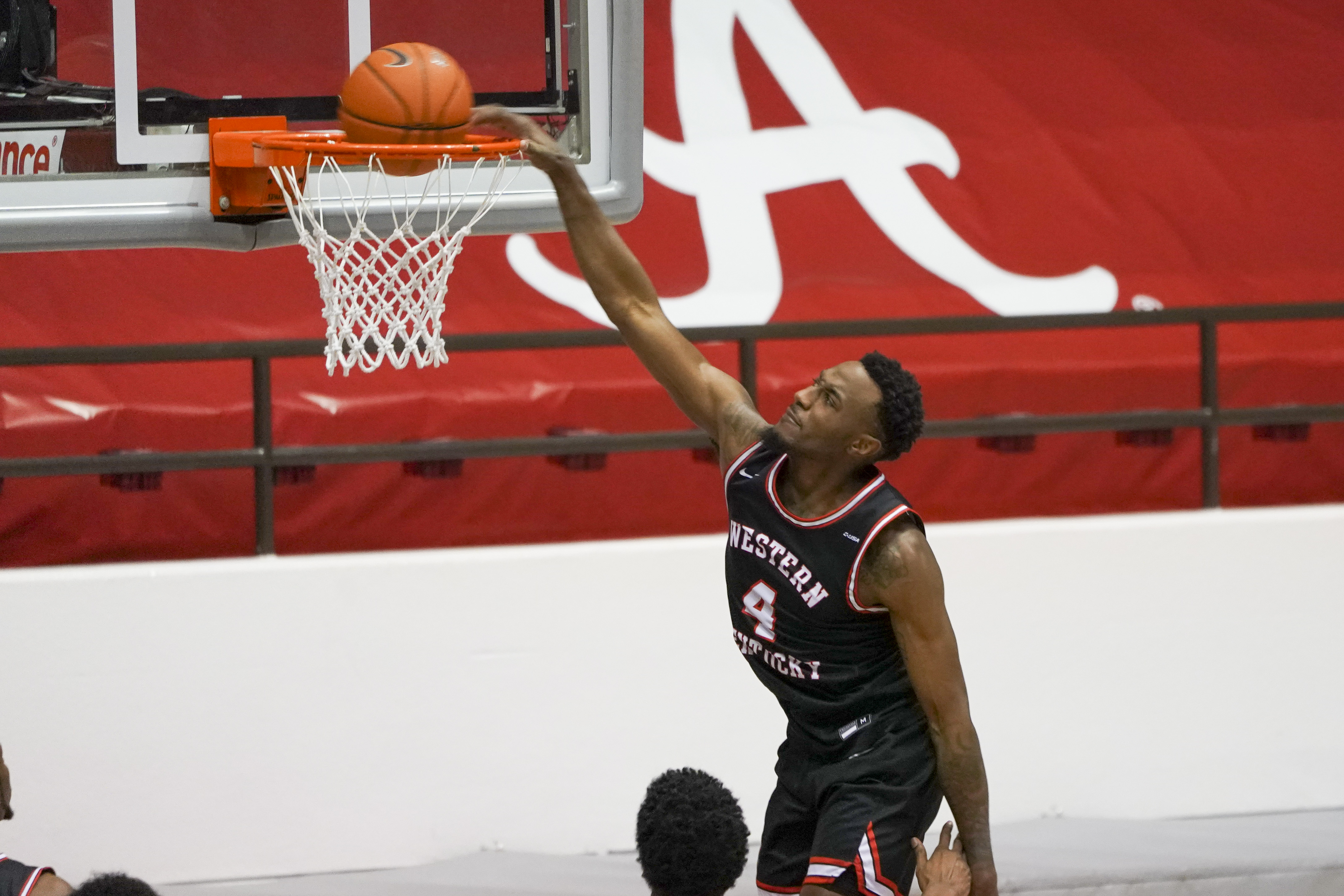 Western Kentucky Hilltoppers guard Josh Anderson takes the ball to the basket against Alabama Crimson Tide during the second half at Coleman Coliseum.