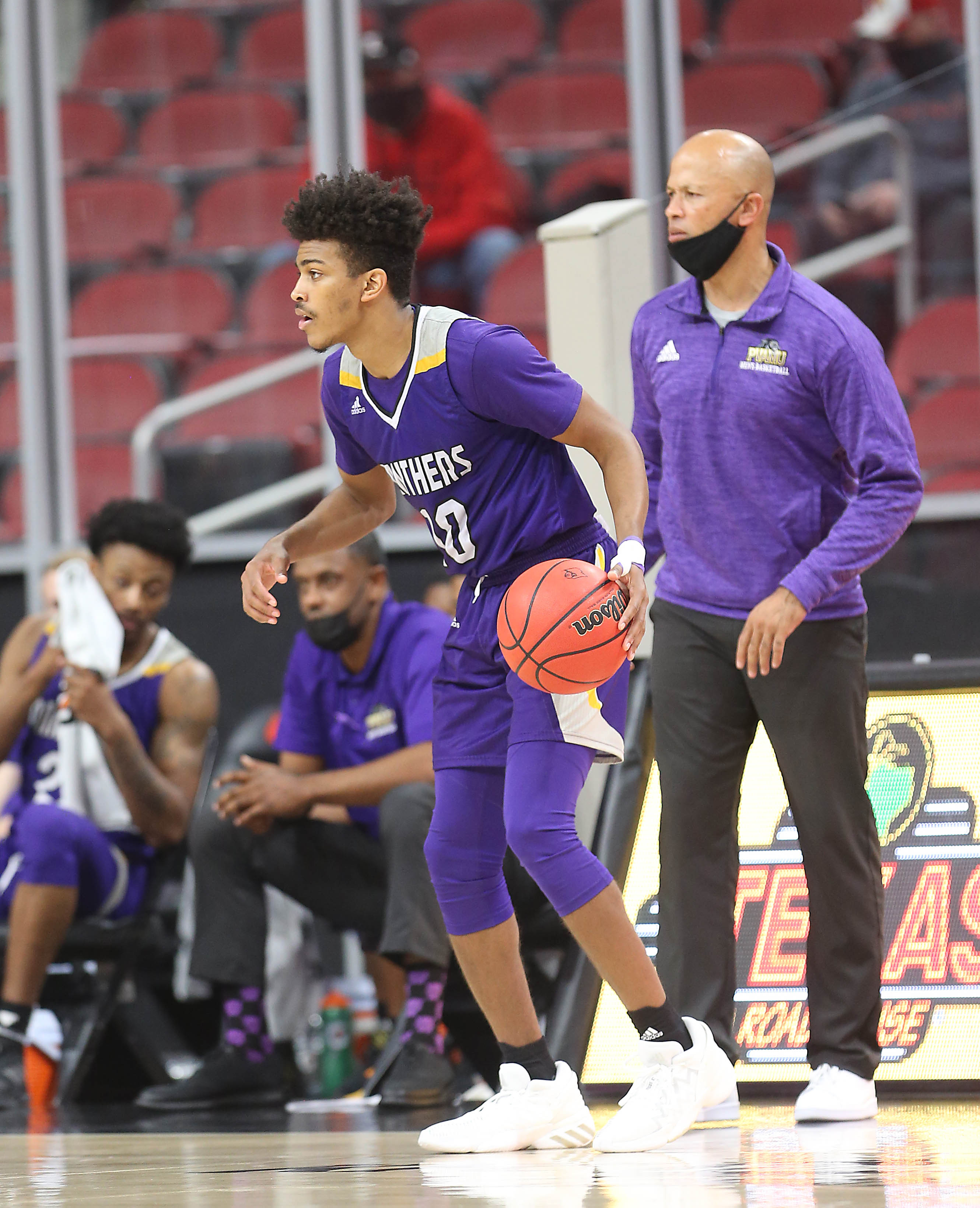 Prairie View player Jeremiah Gambrell Jr. brings the ball up court against Louisville at the KFC Yum! Center.