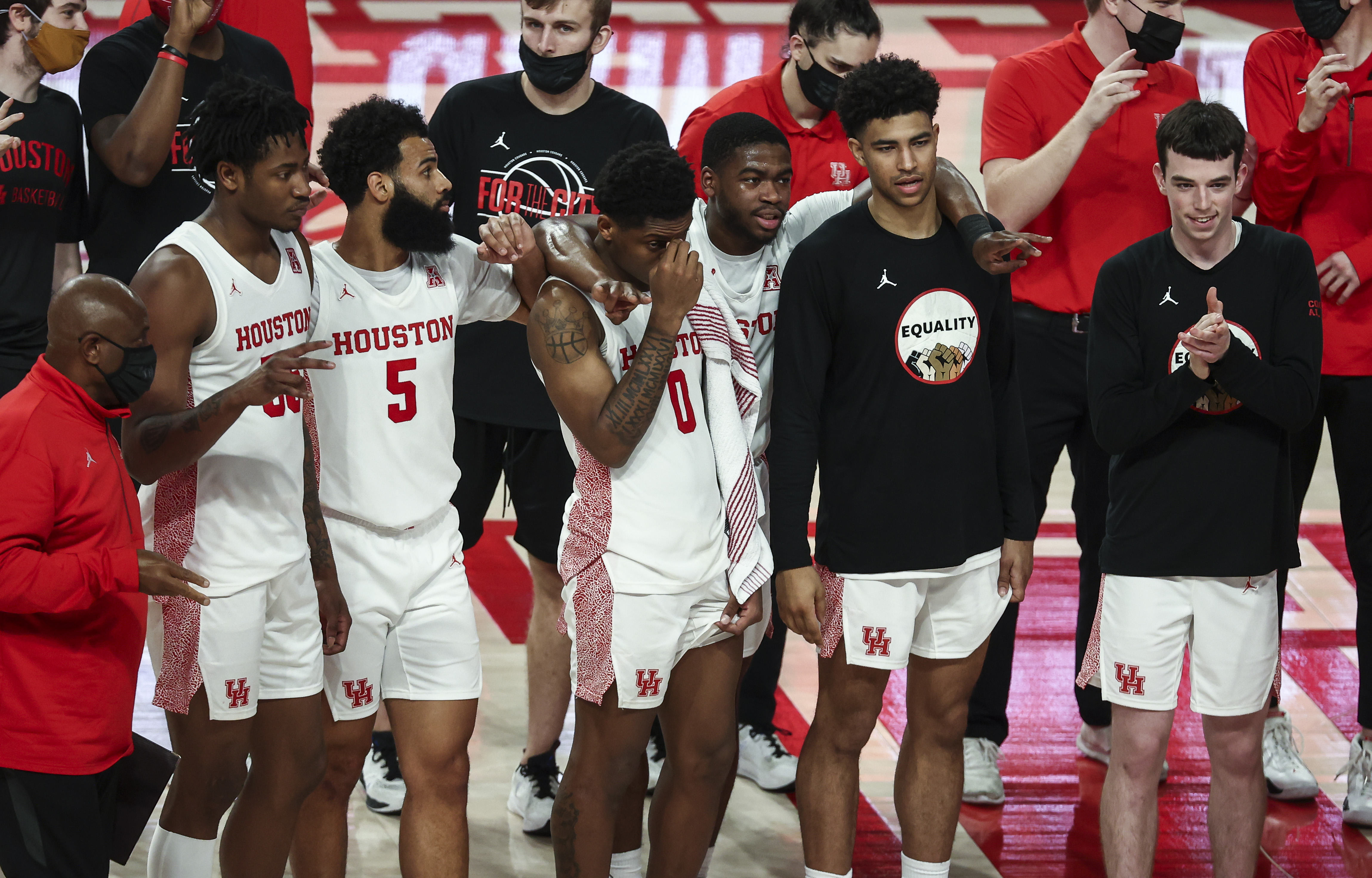 Houston Cougars players stand on the court after the game against the South Florida Bulls at Fertitta Center.