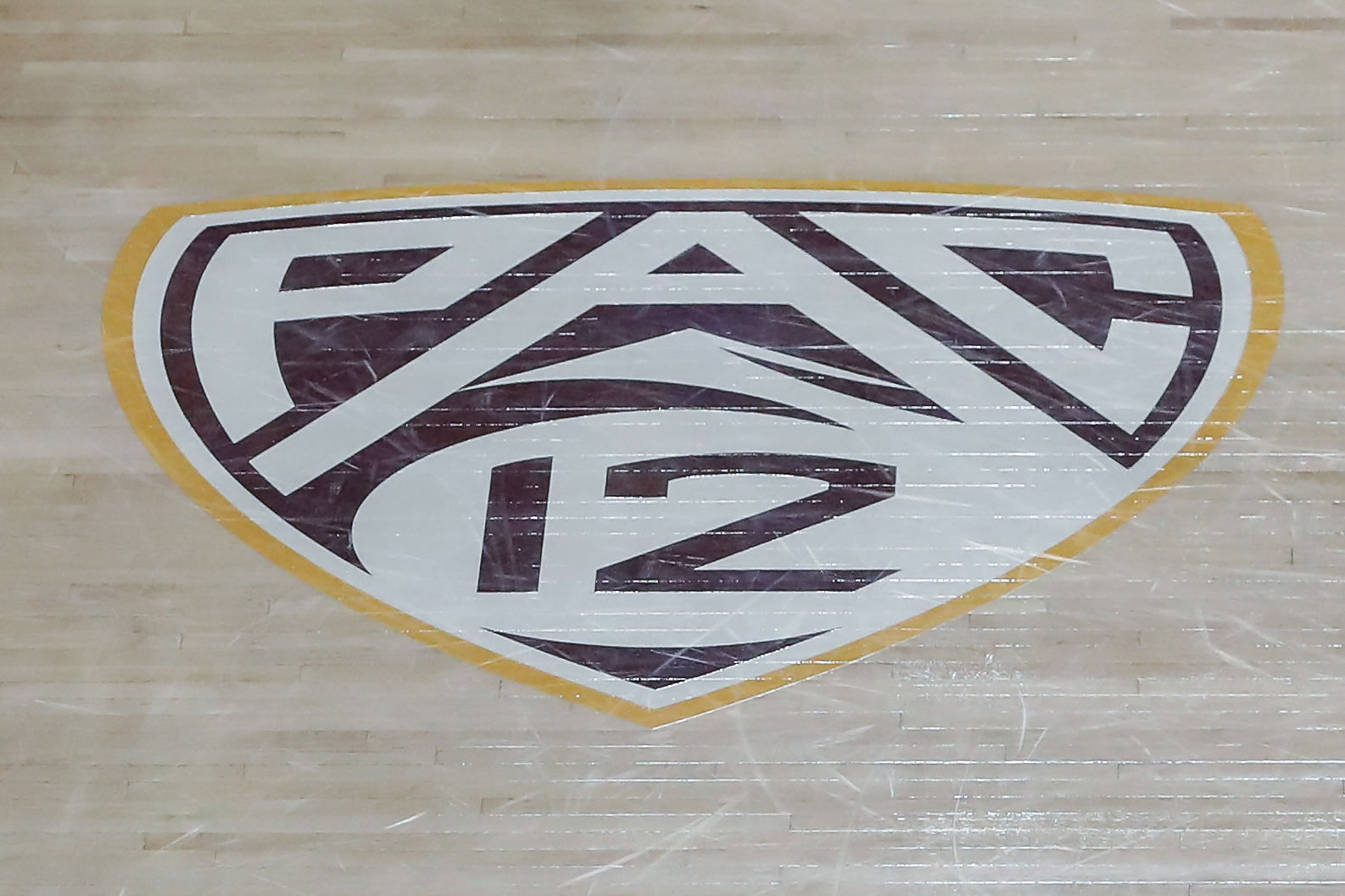 A Pac 12 logo on the court before the college basketball game between the UCLA Bruins and the Arizona State Sun Devils on January 7, 2021 at Desert Financial Arena in Tempe, Arizona.