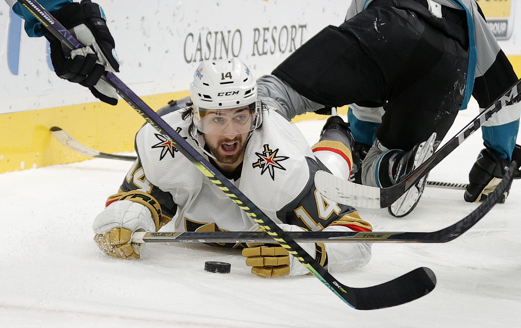 Nicolas Hague #14 of the Vegas Golden Knights goes for the puck while sliding on the ice during the third period against the San Jose Sharks at SAP Center on March 06, 2021 in San Jose, California.