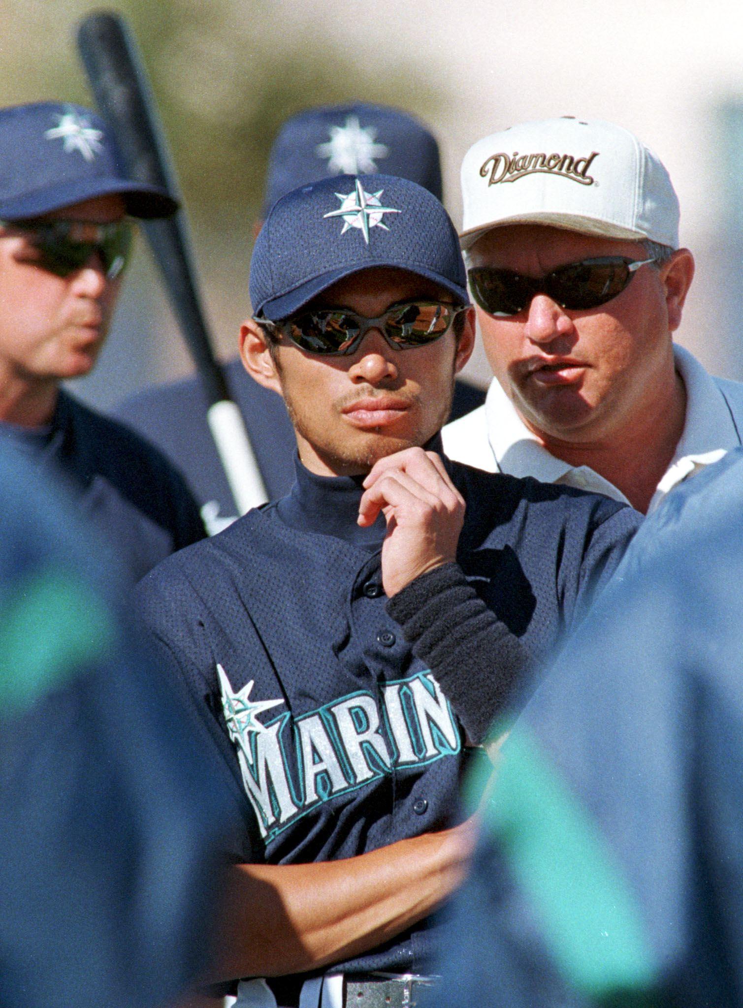Japanese baseball player Ichiro Suzuki(C) listens,