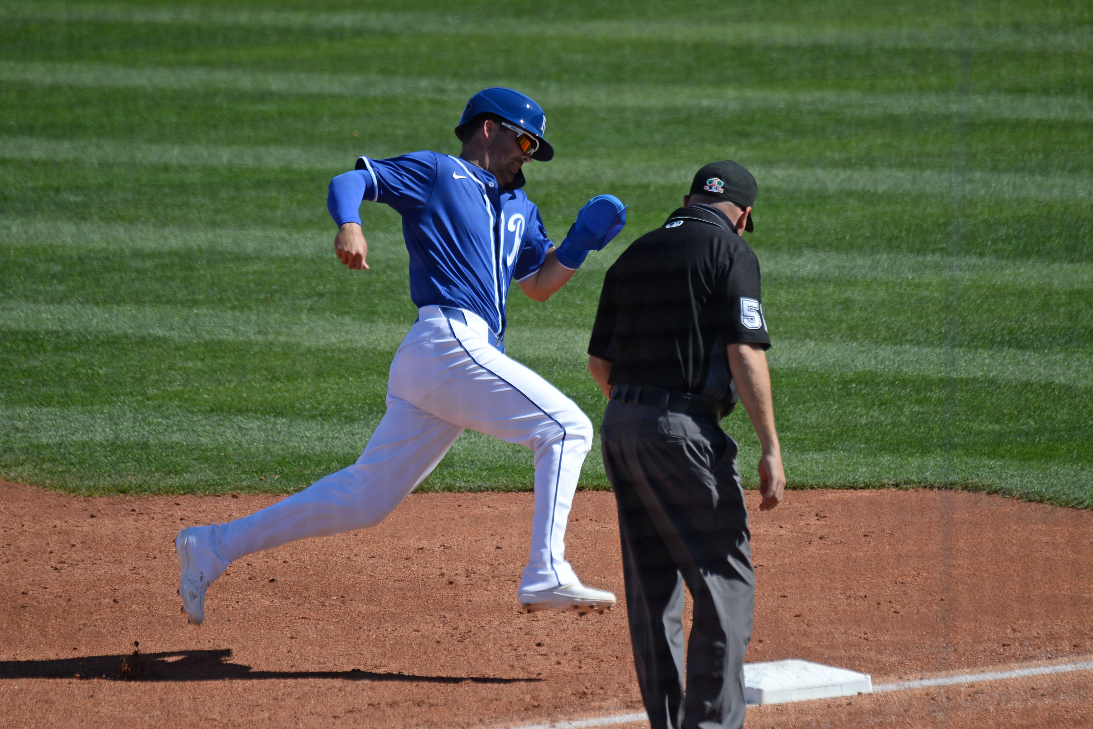 Kansas City Royals second baseman Whit Merrifield (15) rounds third base and scores a run against the Los Angeles Dodgers during the third inning of a spring training game at Surprise Stadium. Mandatory Credit: Joe Camporeale