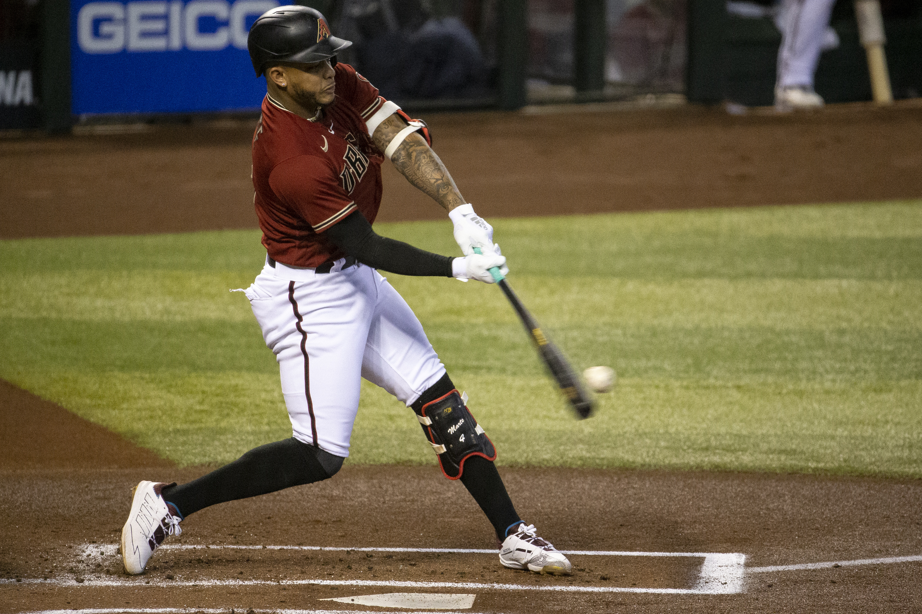 Arizona Diamondbacks player Ketel Marte (4) hits a double against the Colorado Rockies in the first inning at Chase Field.