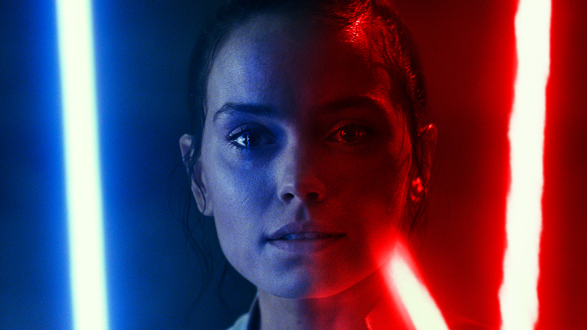 Rey lit by blue and red lightsabers from Star Wars: The Rise of Skywalker