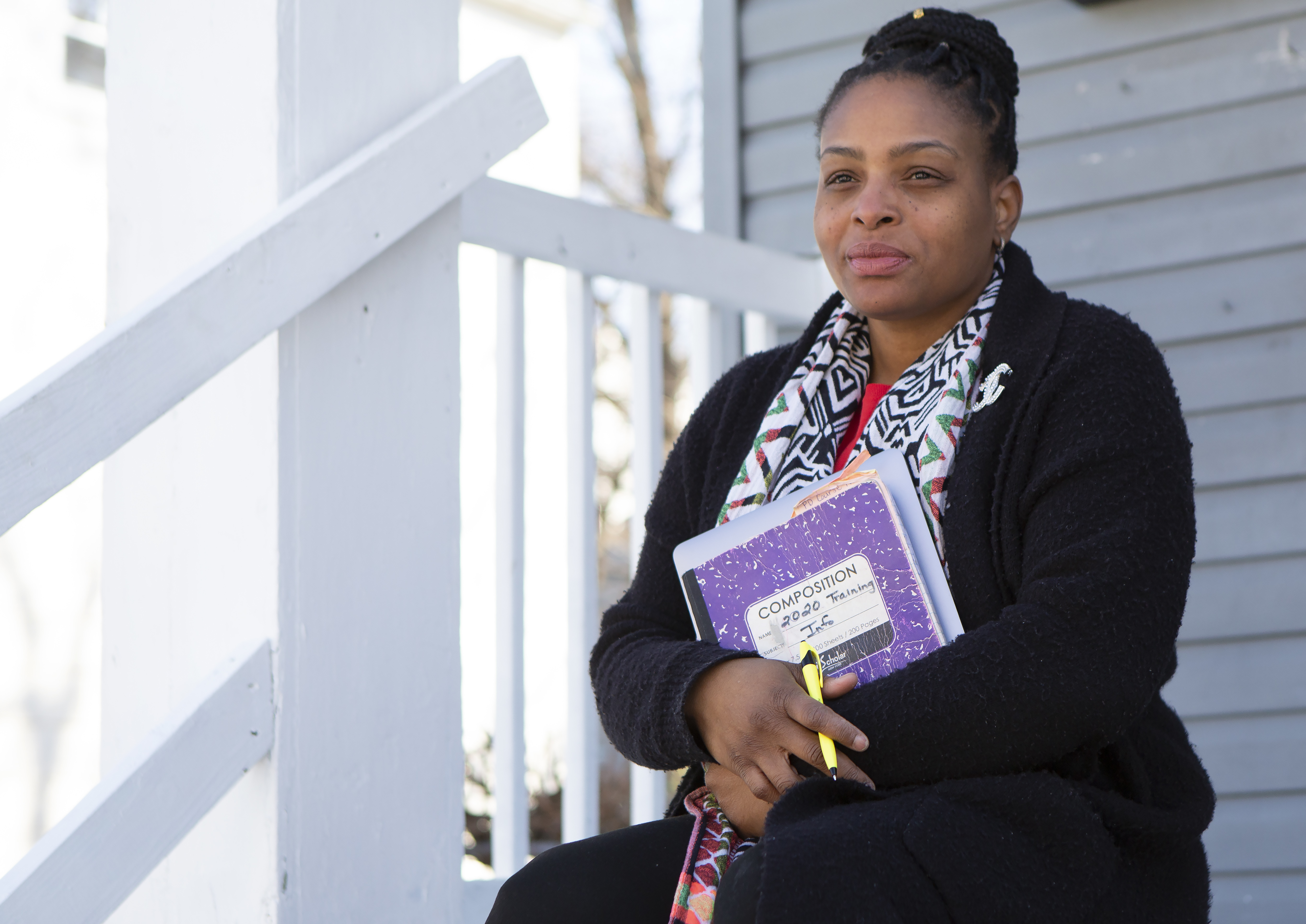 Joicki Floyd poses for a portrait on her porch in Newark.