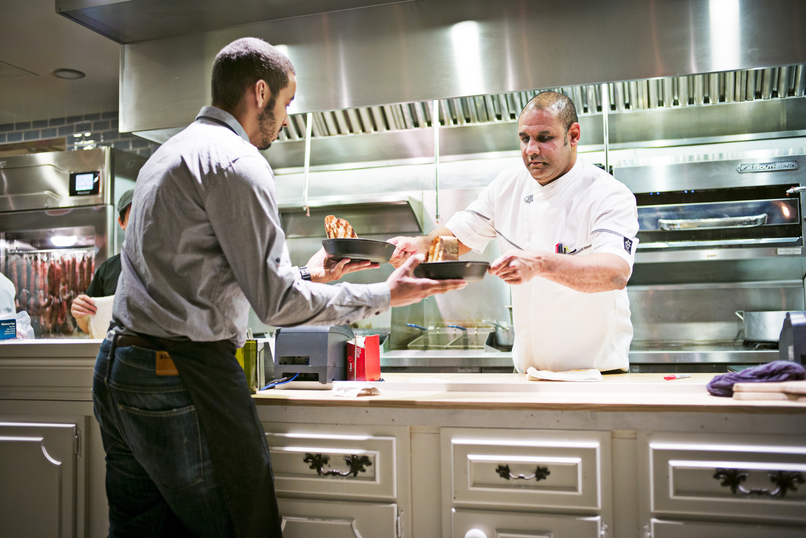 Raynold Mendizábal cooks in the kitchen at Urban Butcher