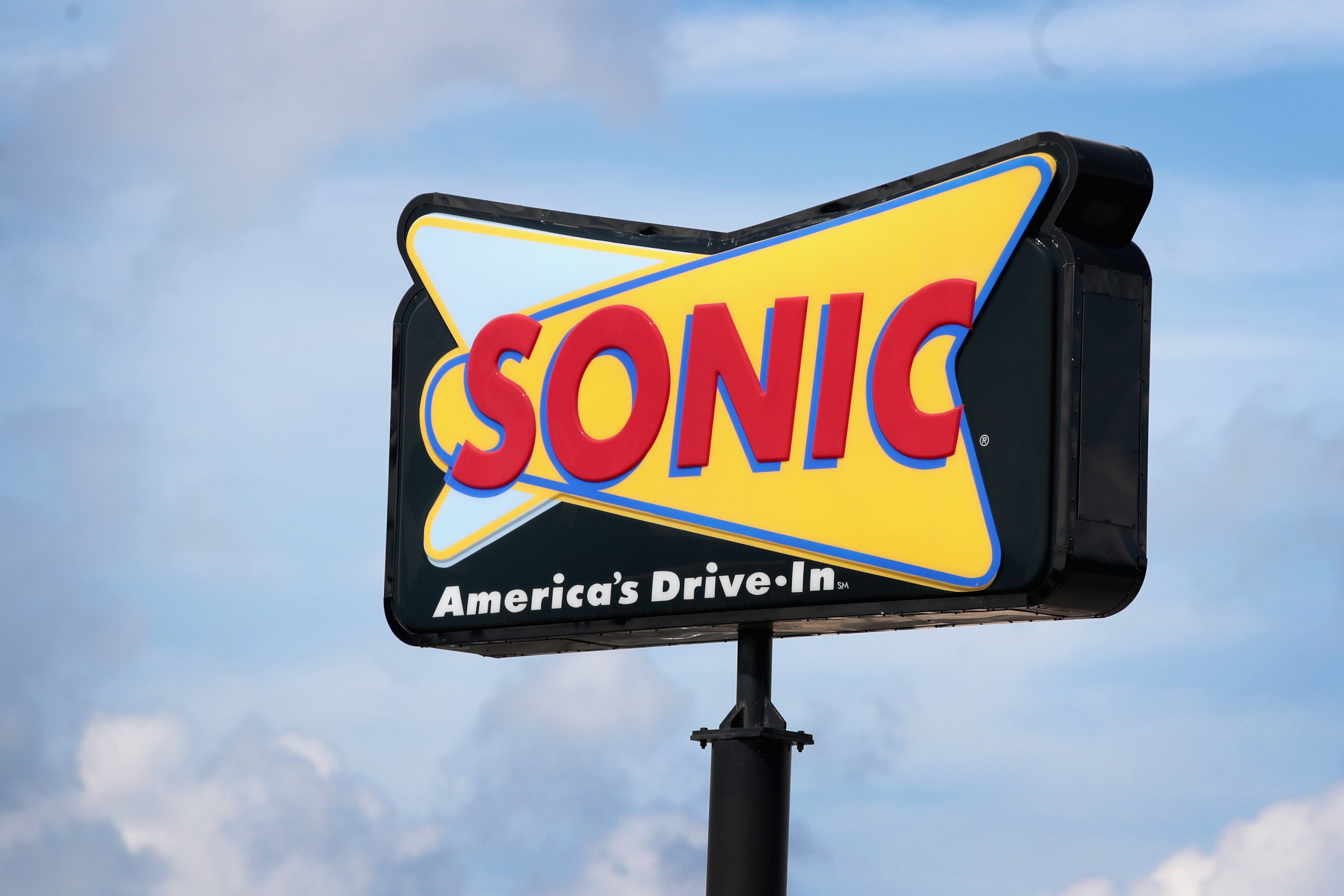 A large Sonic sign against a blue sky background