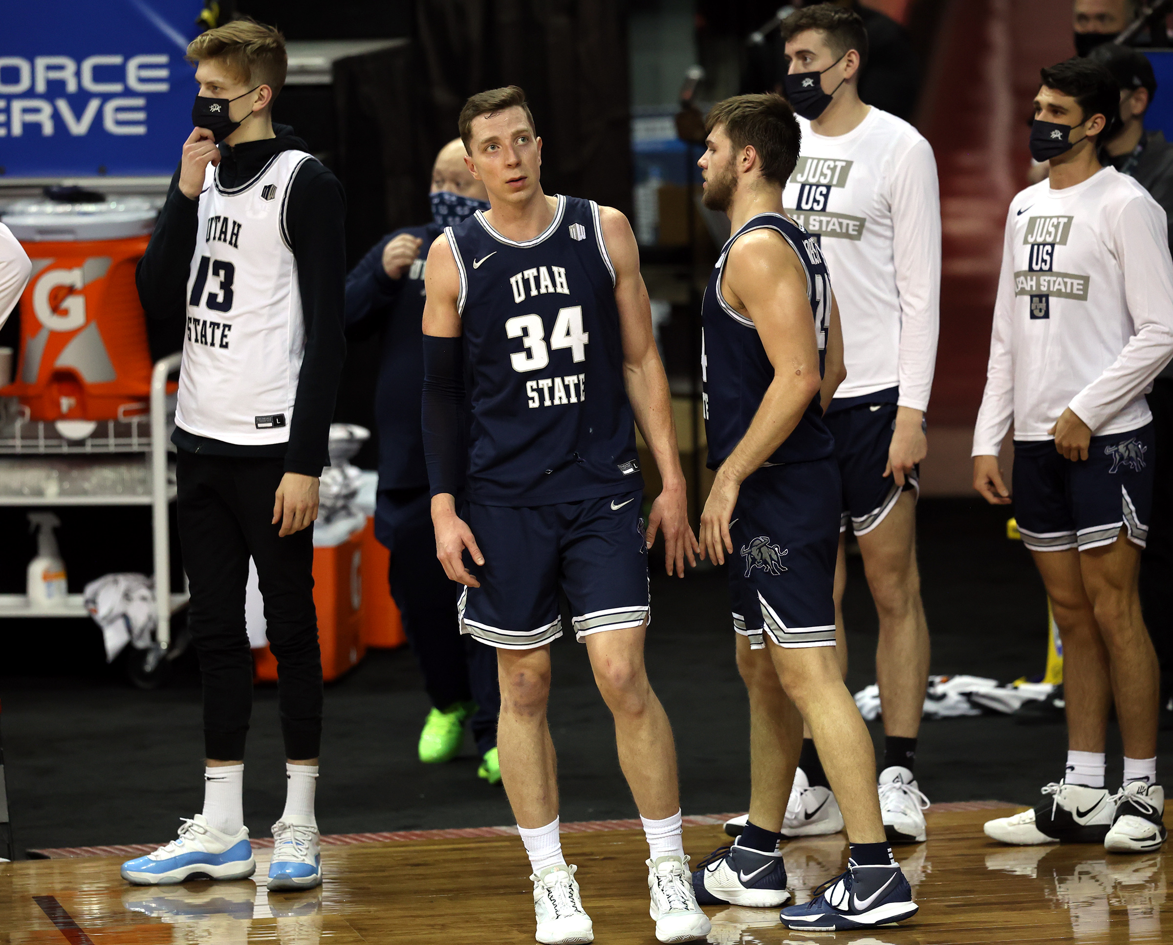 Utah State players watch as the final seconds tick away as they fall 68-57 to San Diego State in the championship game of the Mountain West Tournament at the Thomas & Mack Center in Las Vegas on Saturday, March 13, 2021.