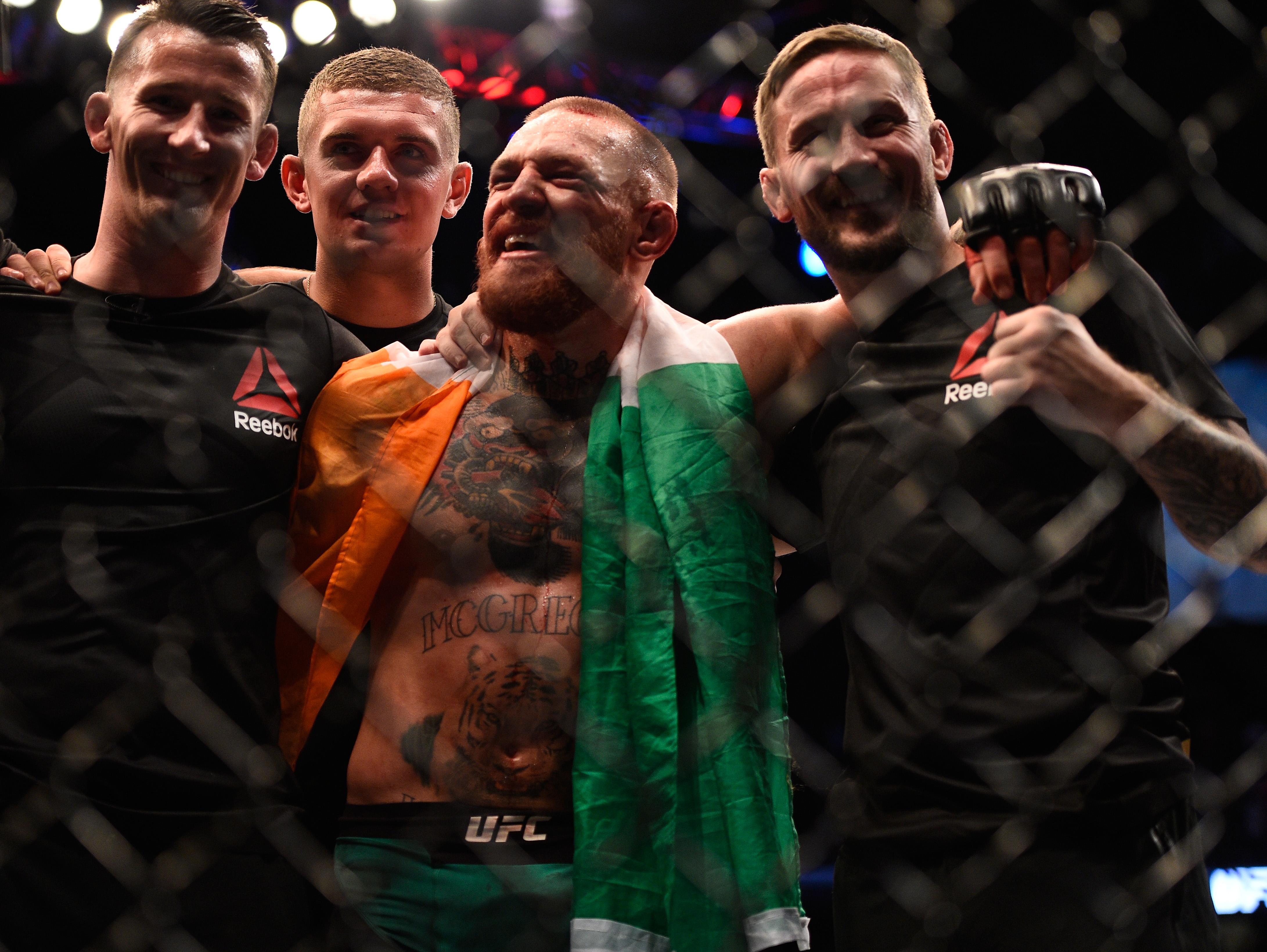 McGregor celebrates with John Kavanagh at UFC 202.gor 2