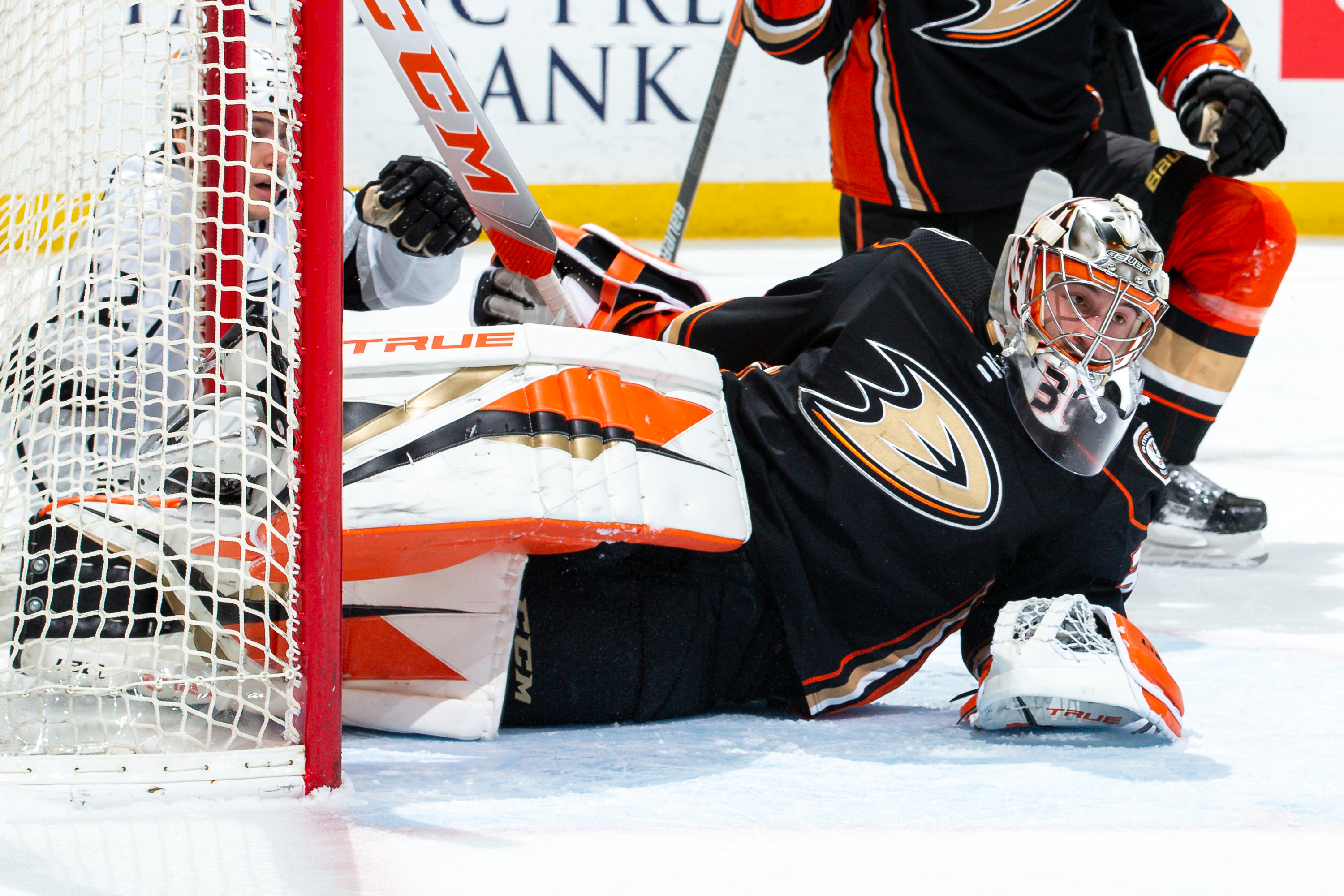 Goaltender John Gibson #36 of the Anaheim Ducks lies on the ice in the crease after players collided with him during the first period of the game against the Los Angeles Kings at Honda Center on March 8, 2021 in Anaheim, California.