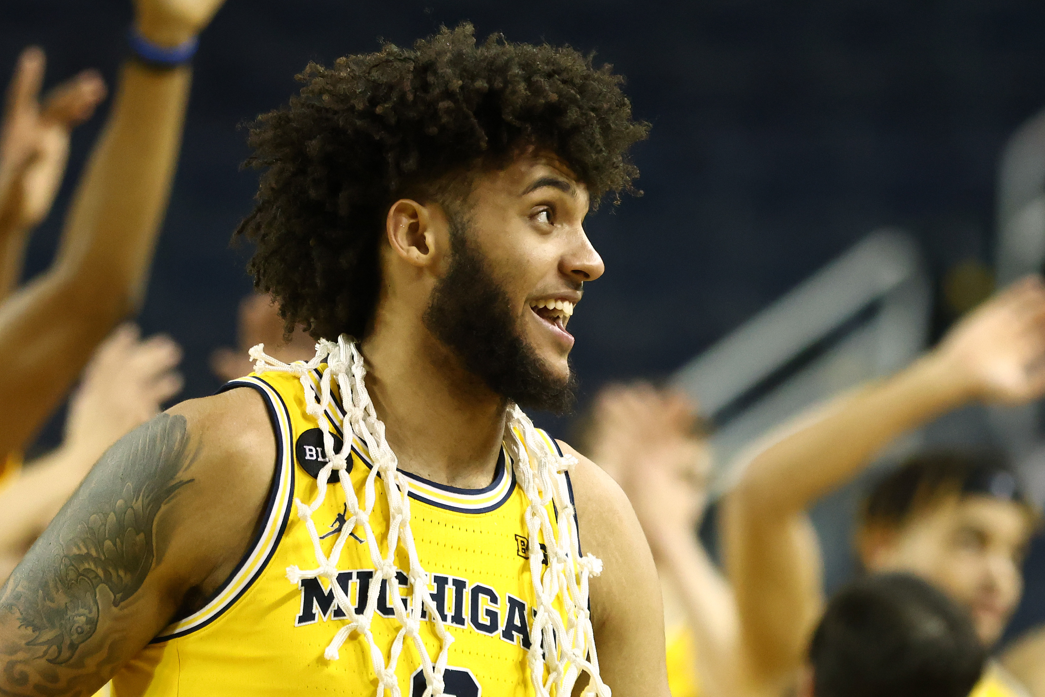 Isaiah Livers #2 of the Michigan Wolverines celebrates senior night and a Big Ten championship after defeating the Michigan State Spartans 69-50 at Crisler Arena on March 04, 2021 in Ann Arbor, Michigan.