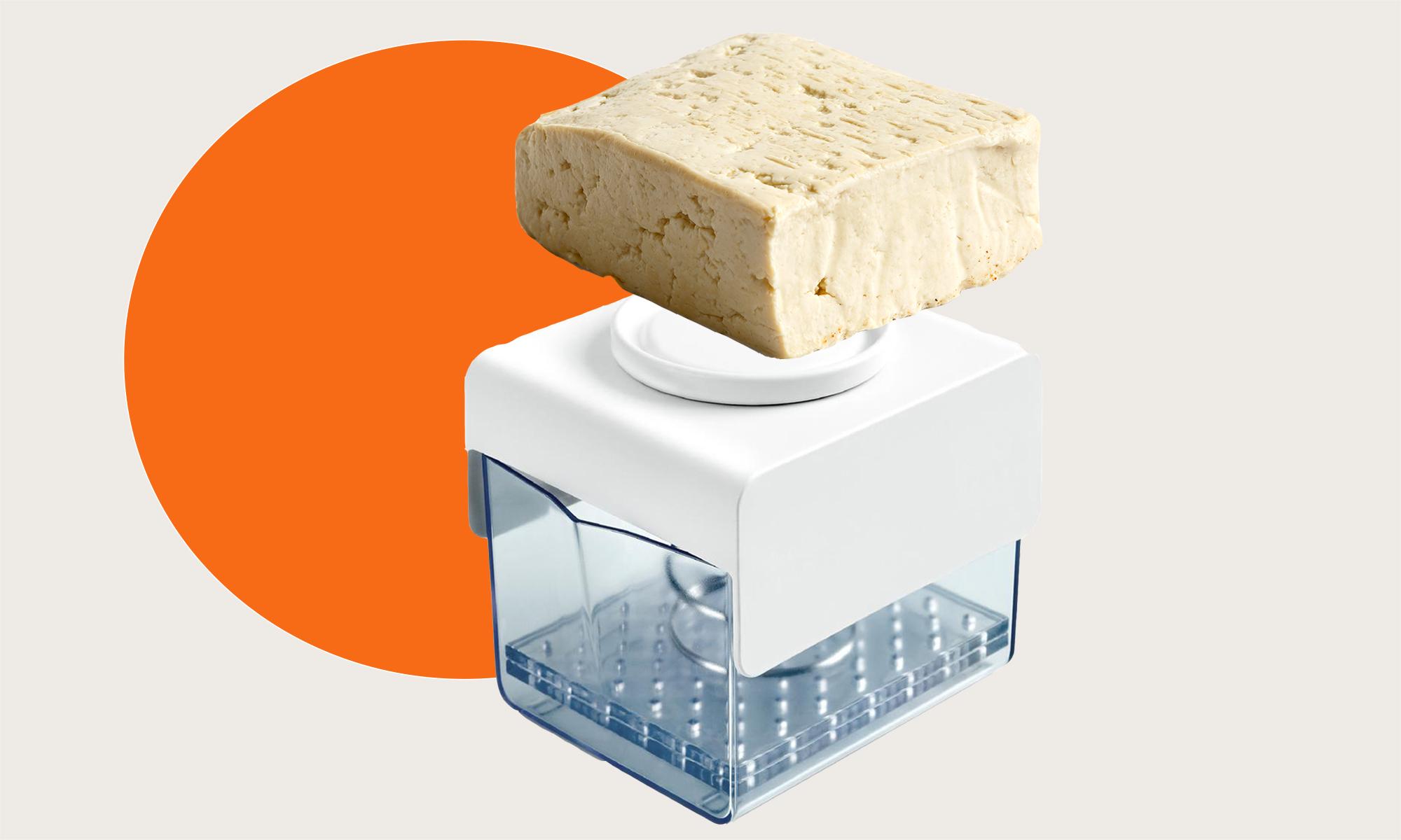 A tofu press and block of tofu