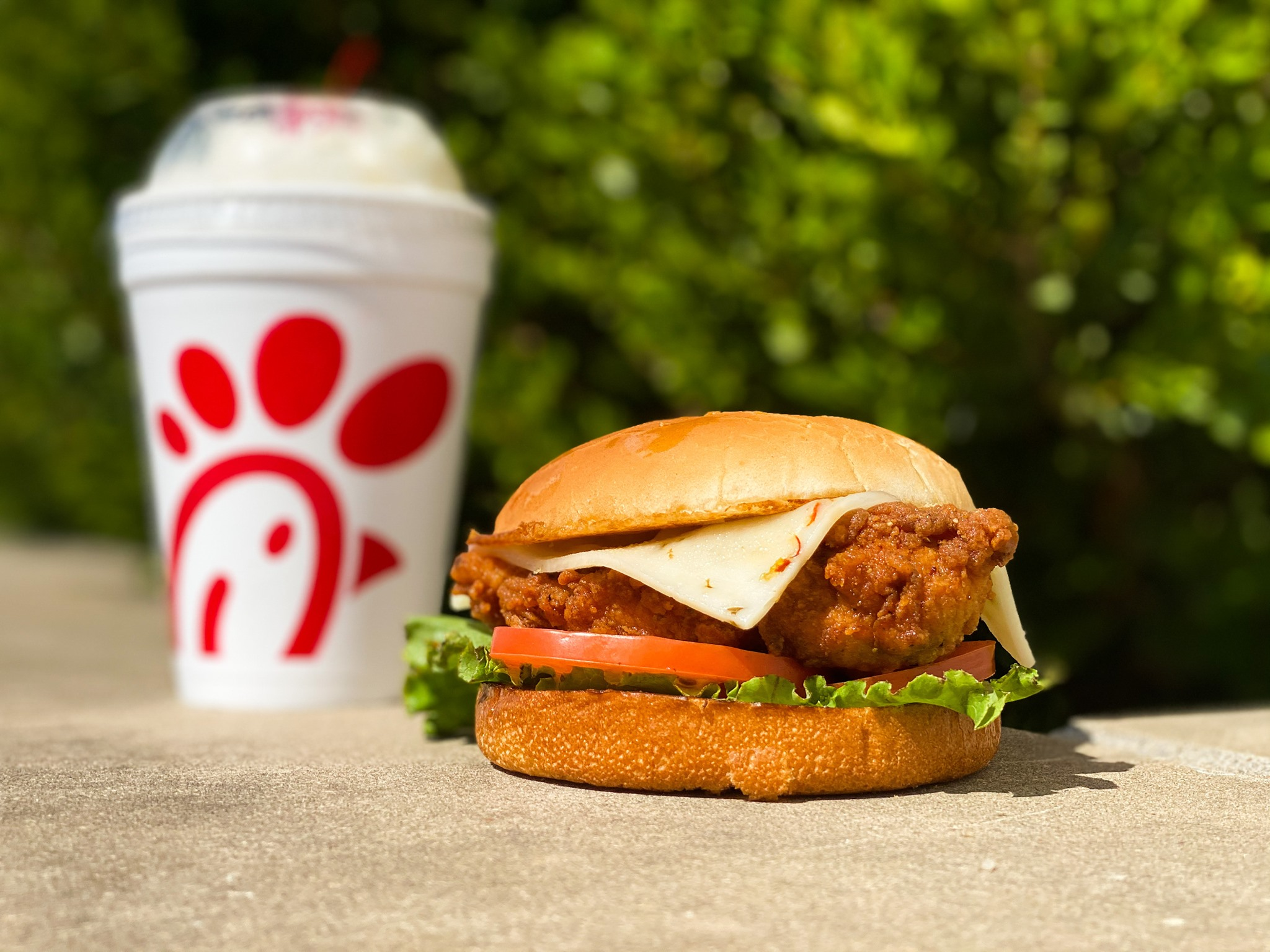 spicy deluxe chicken sandwich and a shake