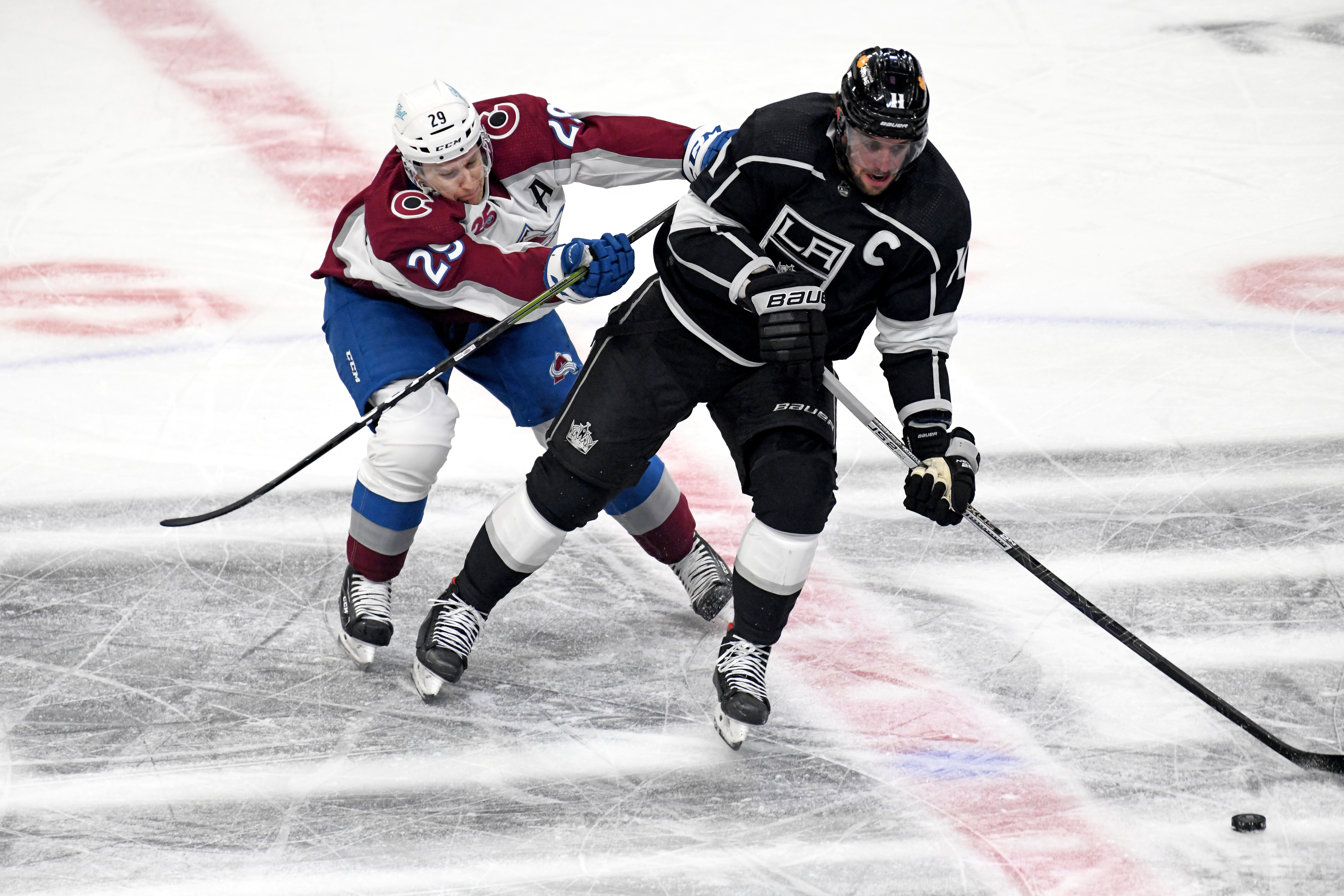 Colorado Avalanche Center Nathan MacKinnon (29) battles with Los Angeles Kings Center Anze Kopitar (11) during a National Hockey League game between the Colorado Avalanche and the Los Angeles Kings on January 21, 2021, at the Staples Center in Los Angeles, CA.