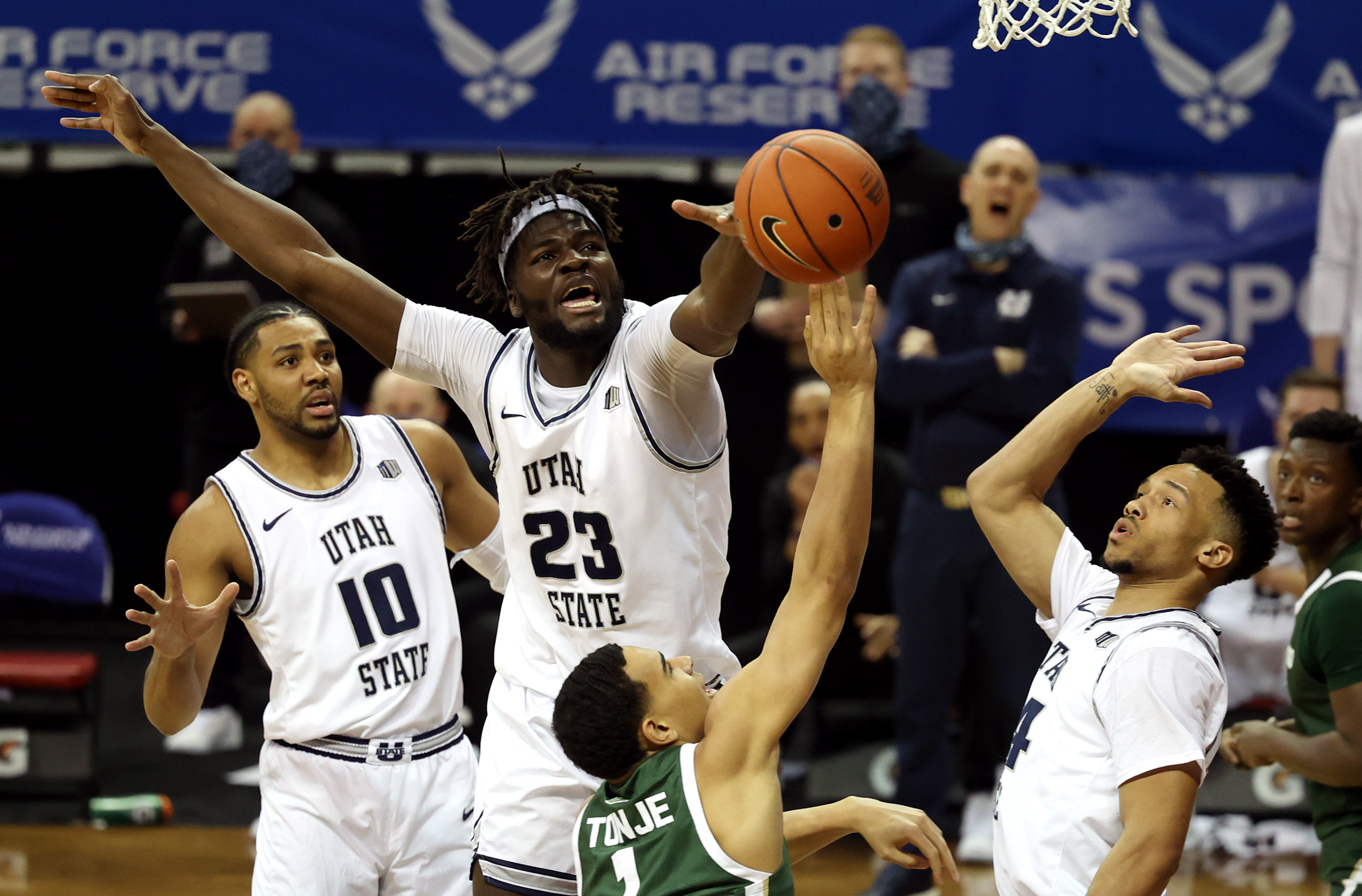 Utah State Aggies center Neemias Queta (23) works to defend Colorado State Rams guard John Tonje (1) as Utah State and Colorado State play in the Mountain West Tournament at the Thomas & Mack Center in Las Vegas on Friday, March 12, 2021.