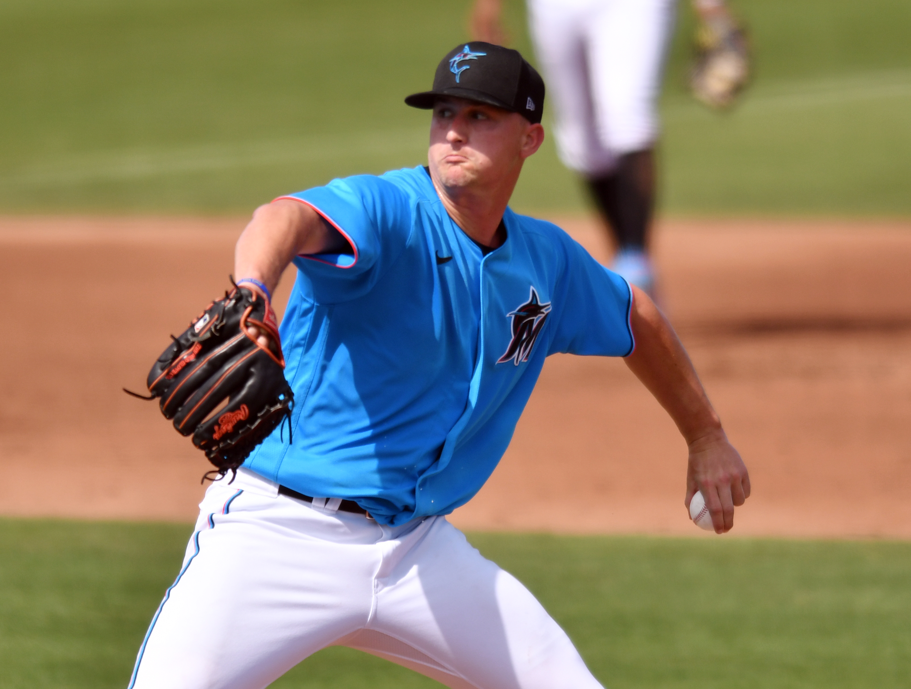 Miami Marlins starting pitcher Braxton Garrett (60) pitches against the St. Louis Cardinals during a spring training game at Roger Dean Chevrolet Stadium.