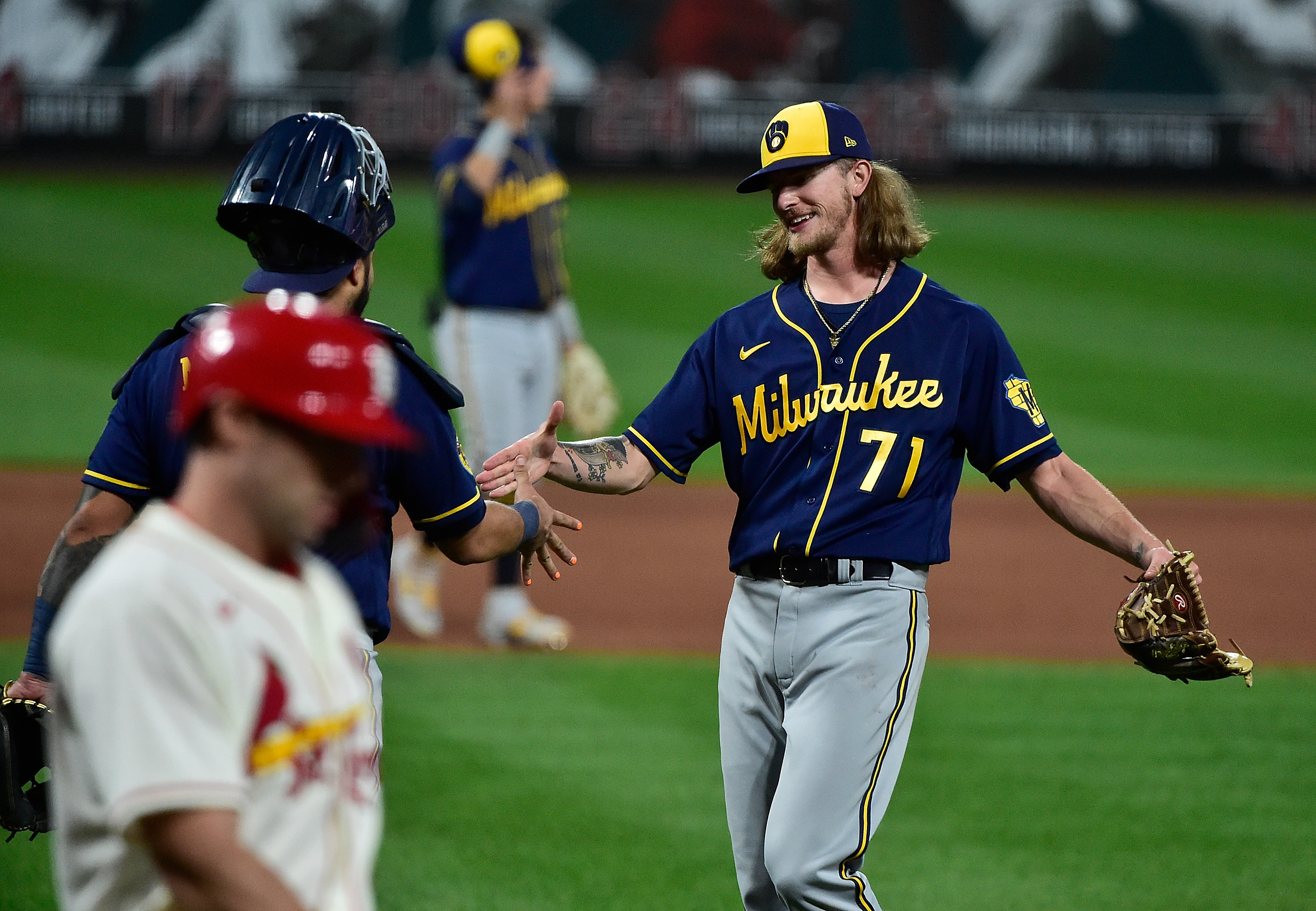 Milwaukee Brewers relief pitcher Josh Hader celebrates with catcher Omar Narvaez after getting St. Louis Cardinals first baseman Paul Goldschmidt to pop out to end the game at Busch Stadium.