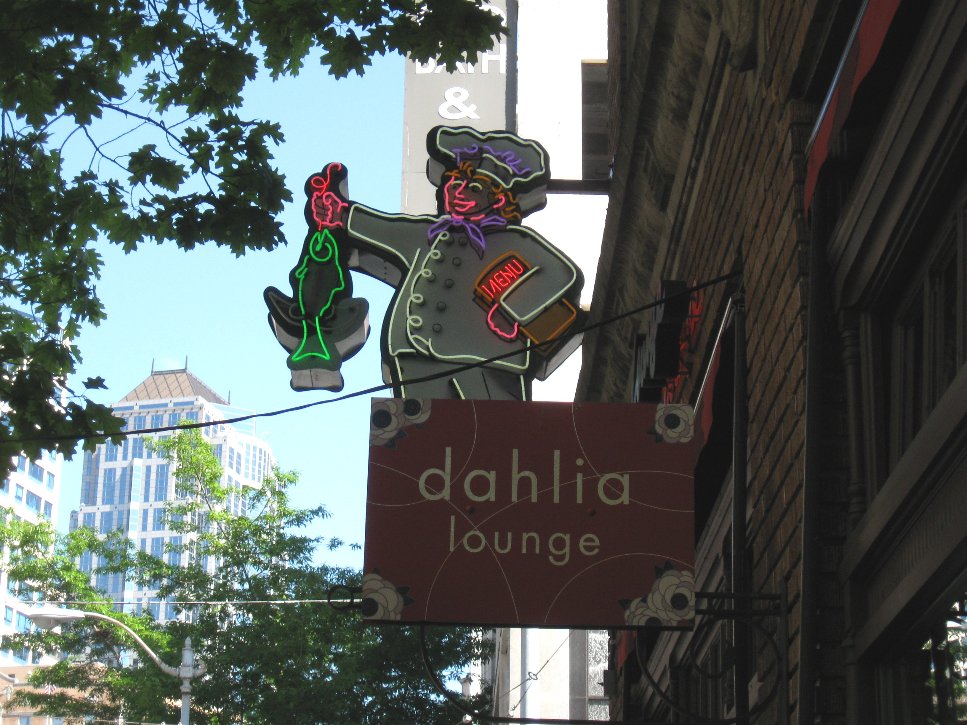 The famed neon sign —with a chef holding a fish — outside Dahlia Lounge in downtown Seattle