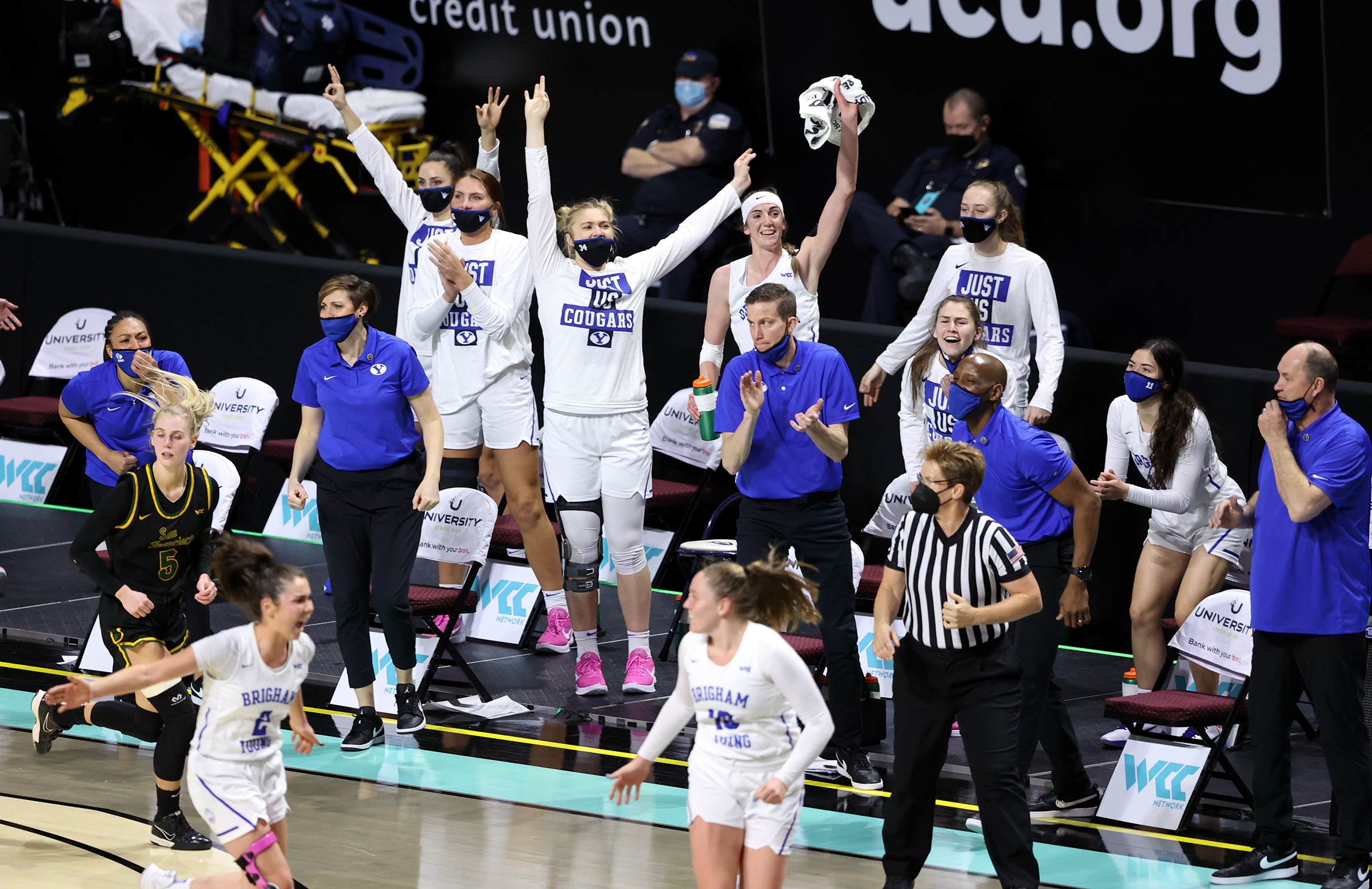 BYU coaches and players celebrate after a 3-point make as they and San Francisco play in West Coast Conference basketball tournament semifinal action at the Orleans Arena in Las Vegas on Monday, March 8, 2021. BYU won 85-55 to advance to the finals against Gonzaga.
