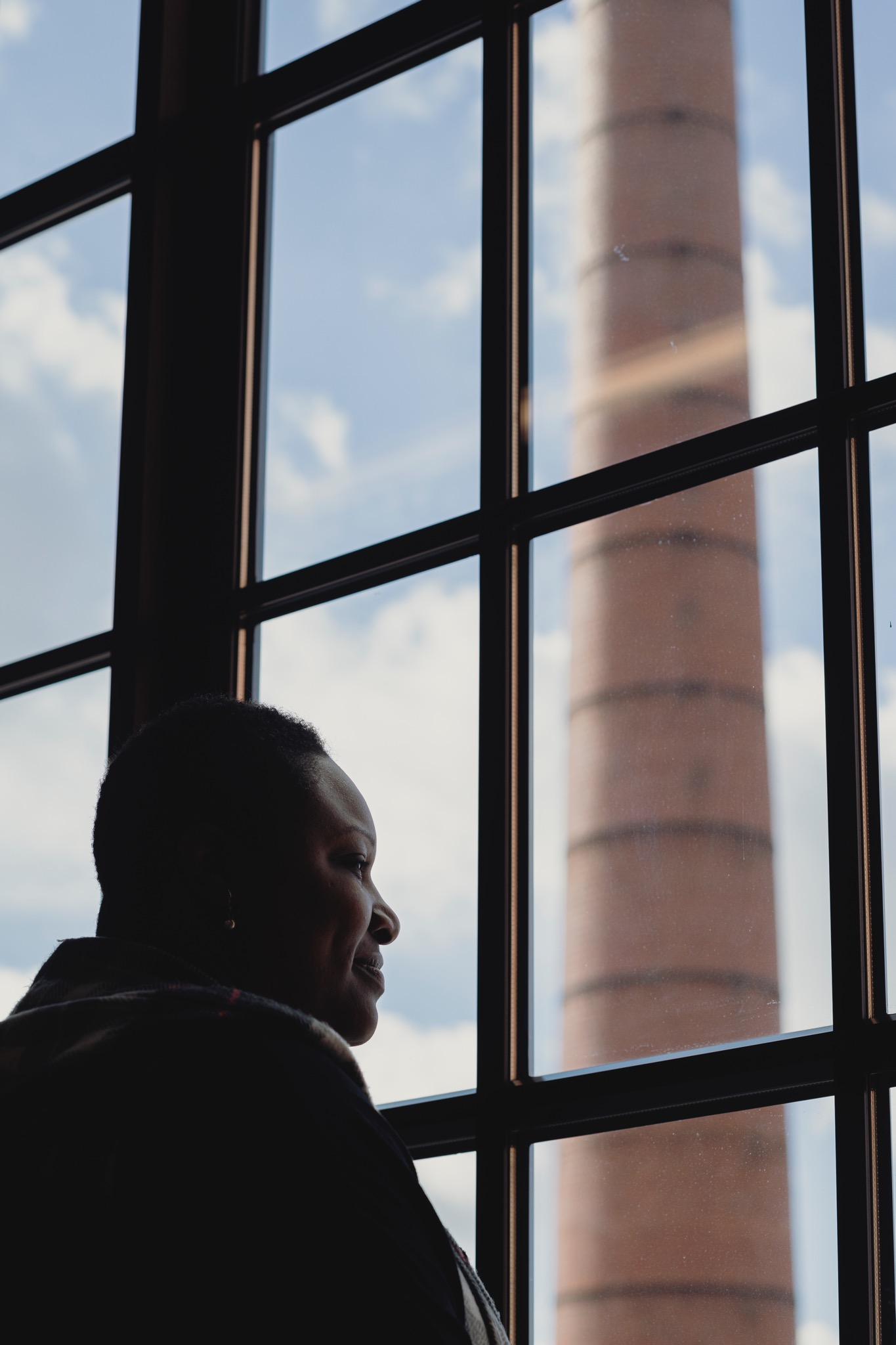 Purdue Polytechnic High School Principal Shatoya Ward looks out a window.