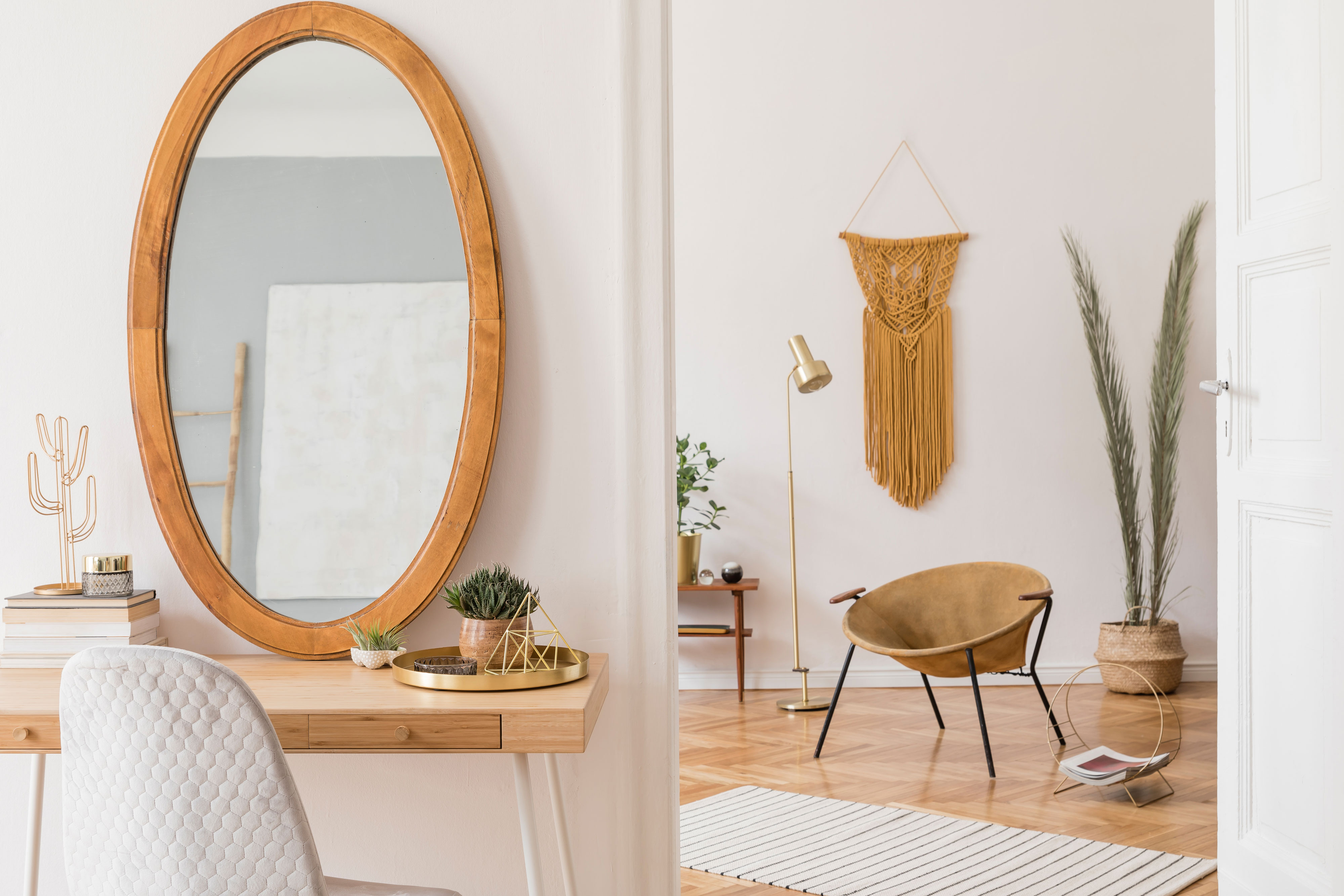 Oval mirror with wooden frame on table