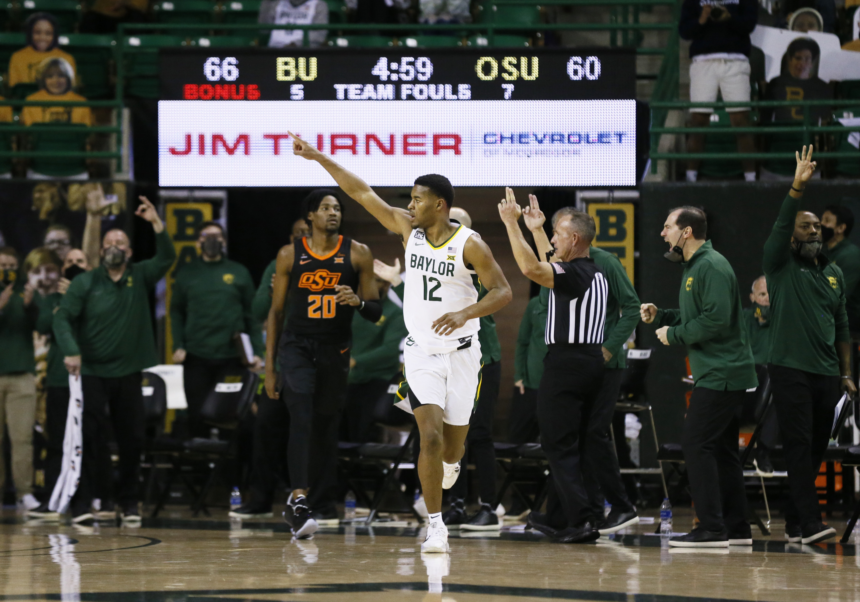 Baylor Bears guard Jared Butler (12) reacts after a made three-point basket against the Oklahoma State Cowboys during the second half at Ferrell Center.