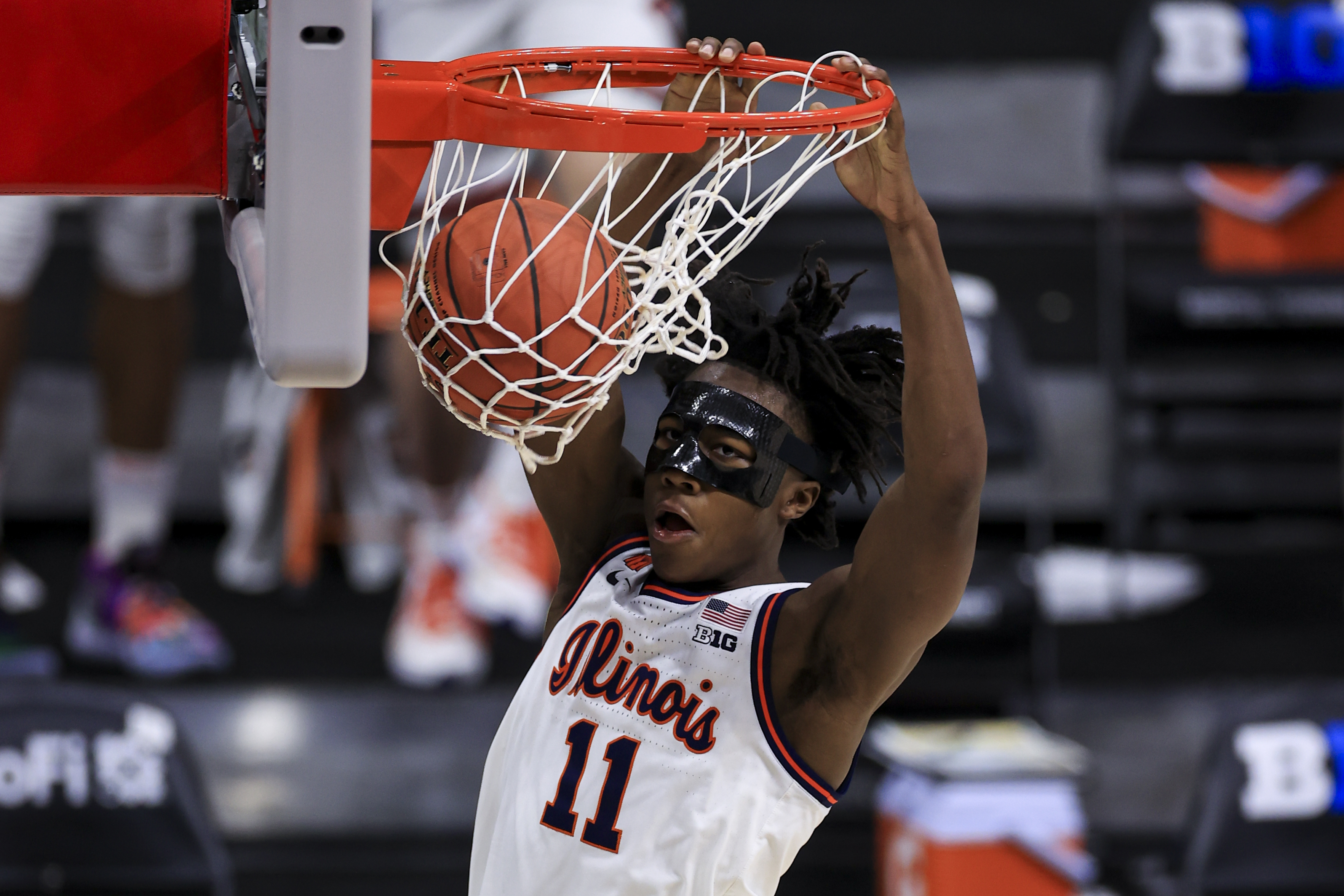 Illinois Fighting Illini guard Ayo Dosunmu (11) dunks the ball against the Iowa Hawkeyes in the second half at Lucas Oil Stadium.