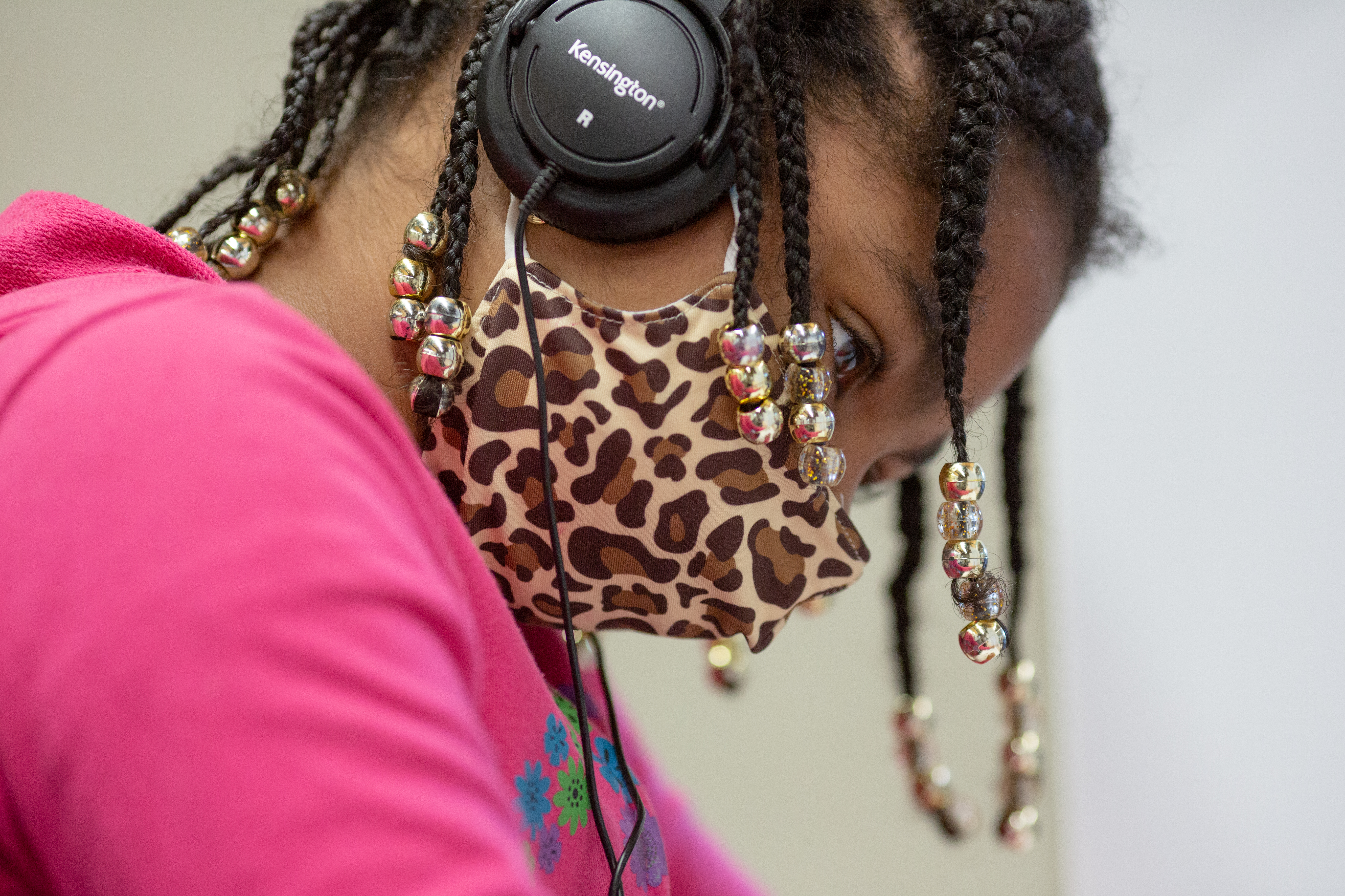 Close up of a student wearing a mask and headphones.