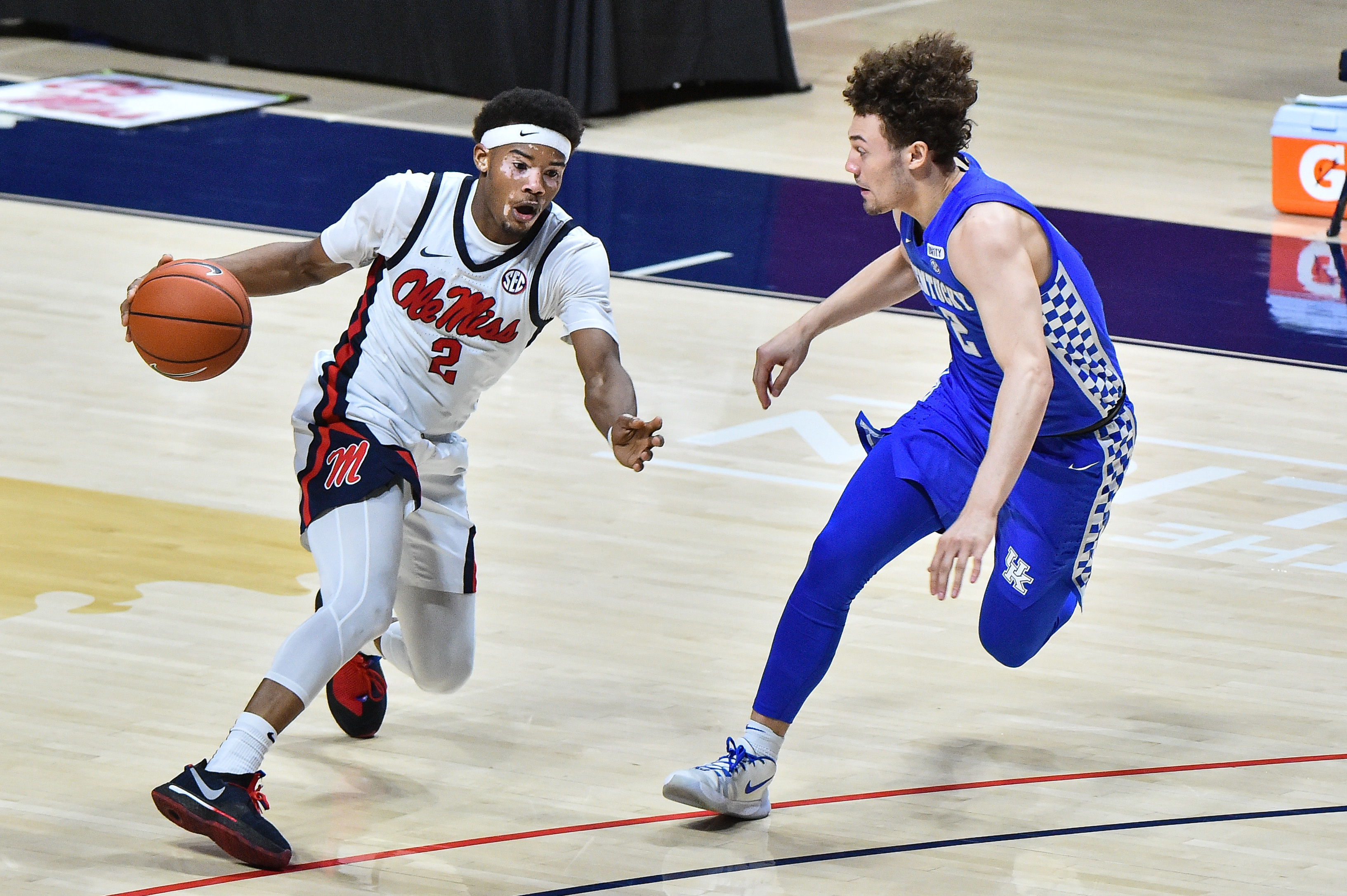 Mississippi Rebels guard Devontae Shuler (2) handles the ball against Kentucky Wildcats guard Devin Askew (2) during the second half at The Pavilion at Ole Miss.