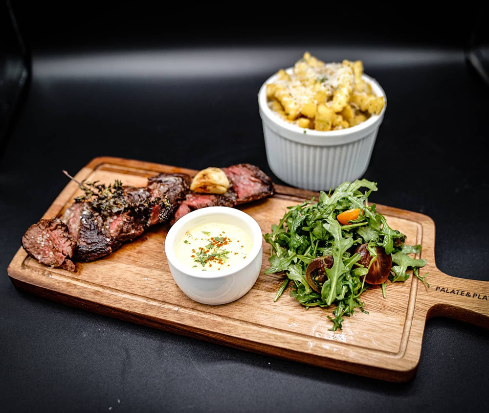Steak frites featuring truffle fries, a 6oz hanger steak and Béarnaise sauce, on the new menu at Salt & Spoon.