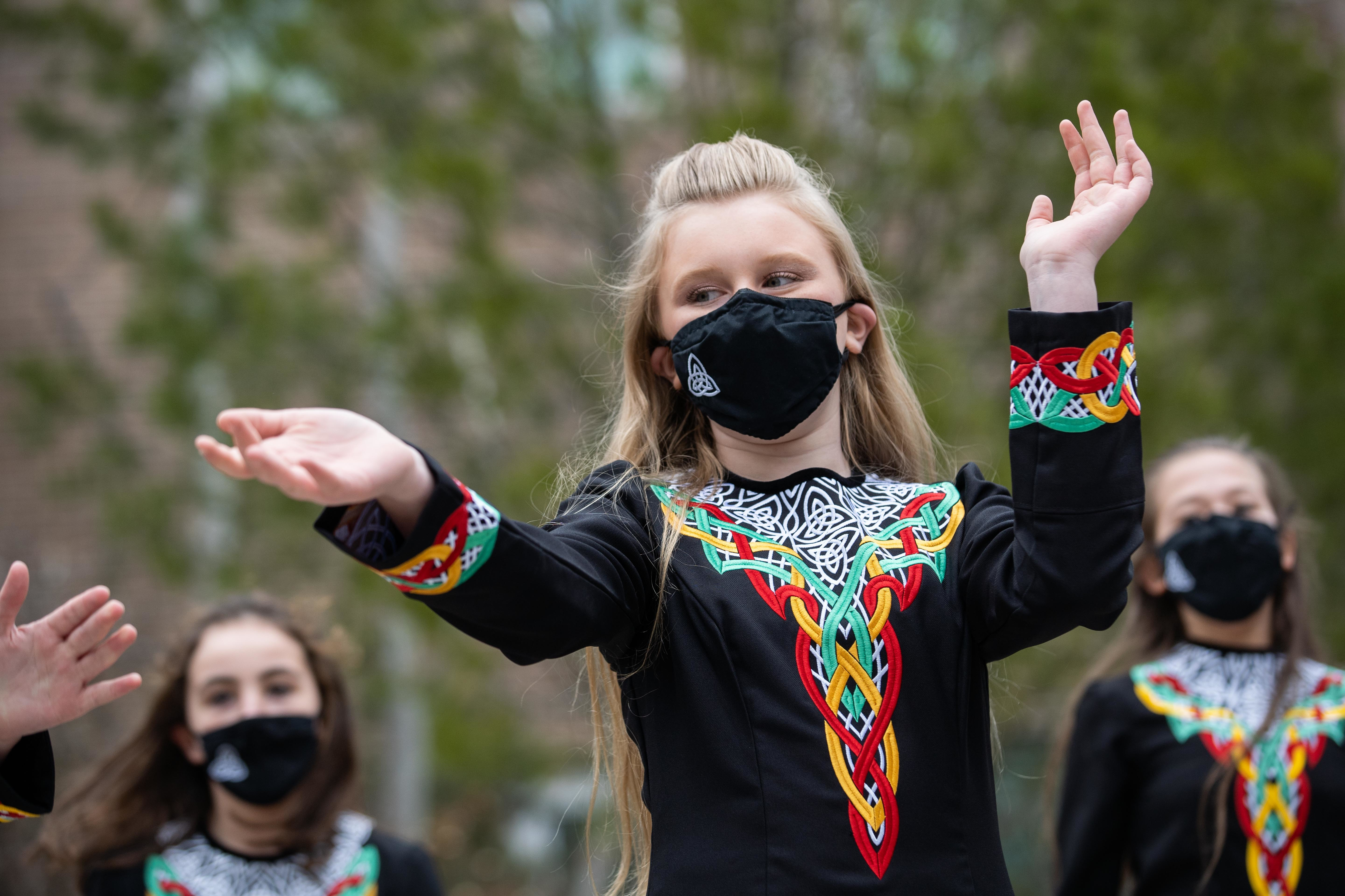 Trinity Irish Dancers perform outside Swedish Covenant Hospital on St. Patrick's Day to show appreciation for health care workers.