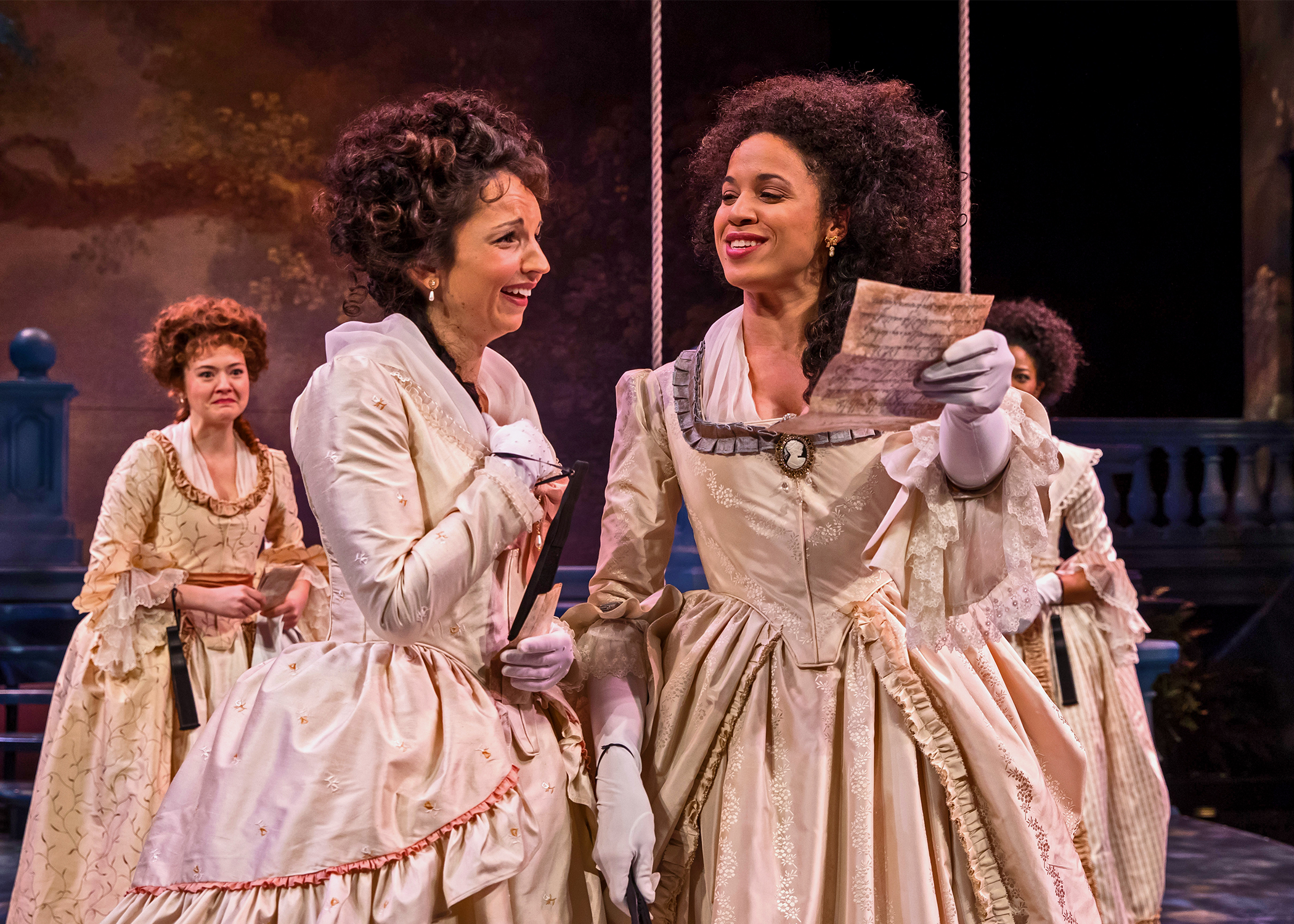 The Princess (Jennie Greenberry, at right) and Rosaline (Laura Rook) gleefully read through a love letter mistakenly delivered into the wrong hands, as Katherine (Taylor Blim) and Maria (Jennifer Latimore) look on in Chicago Shakespeare Theater's production of Love's Labor's Lost, directed by Marti Maraden. Photo by Liz Lauren