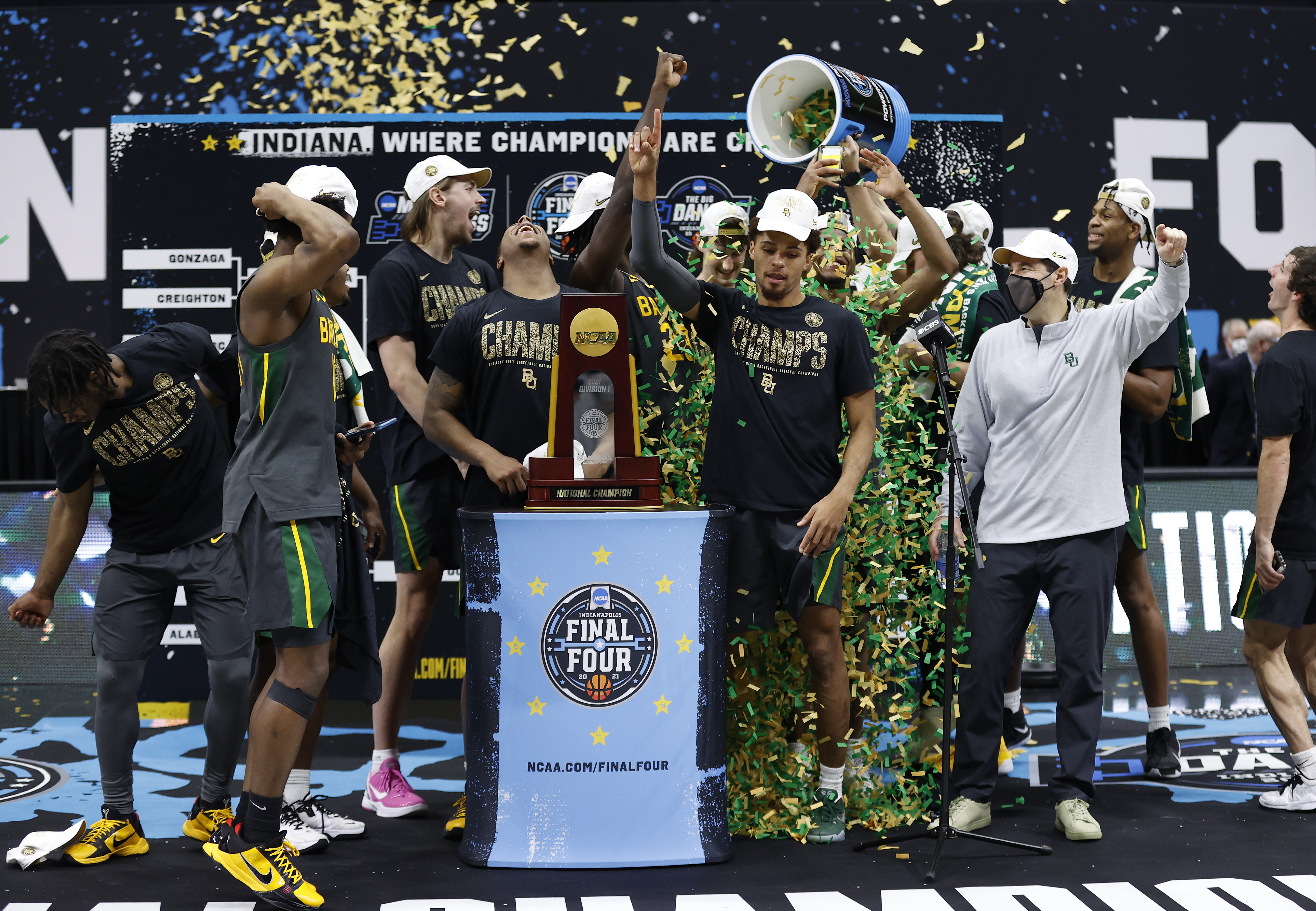 The Baylor Bears celebrate with the trophy after defeating the Gonzaga Bulldogs 86-70 in the National Championship game of the 2021 NCAA Men's Basketball Tournament at Lucas Oil Stadium on April 05, 2021 in Indianapolis, Indiana.