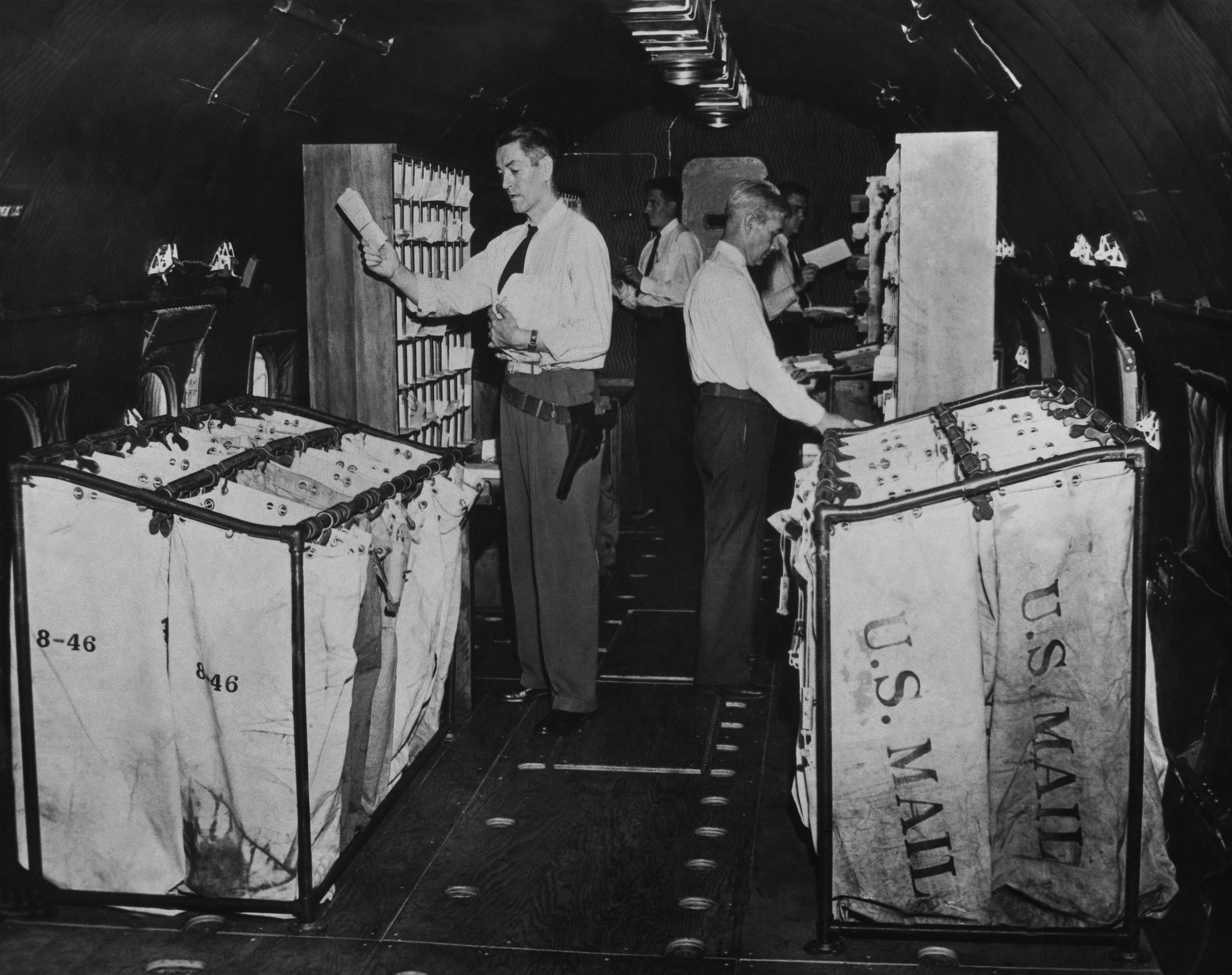 People sort mail into bins circa 1940.