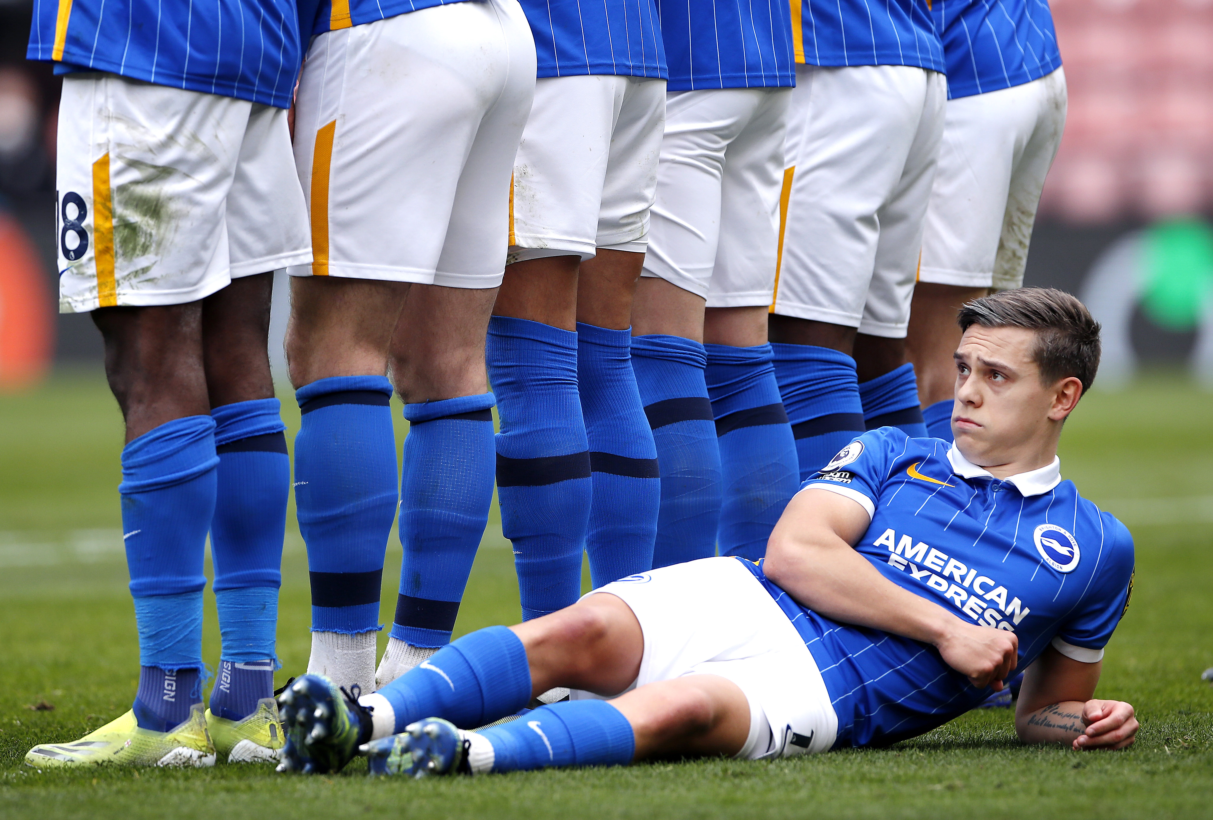 Leandro Trossard of Brighton & Hove Albion lies down behind the wall as he defends a free kick - Brighton & Hove Albion - Premier League