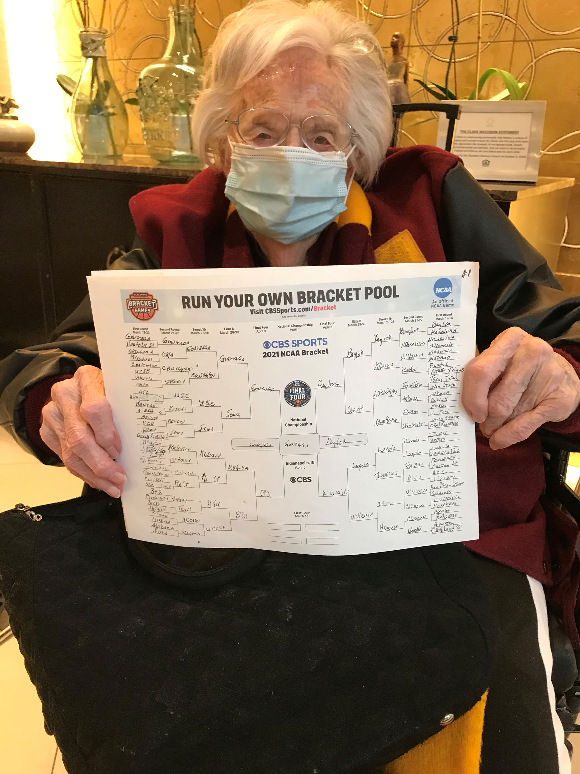 Sister Jean Dolores Schmidt holds up her March Madness bracket.