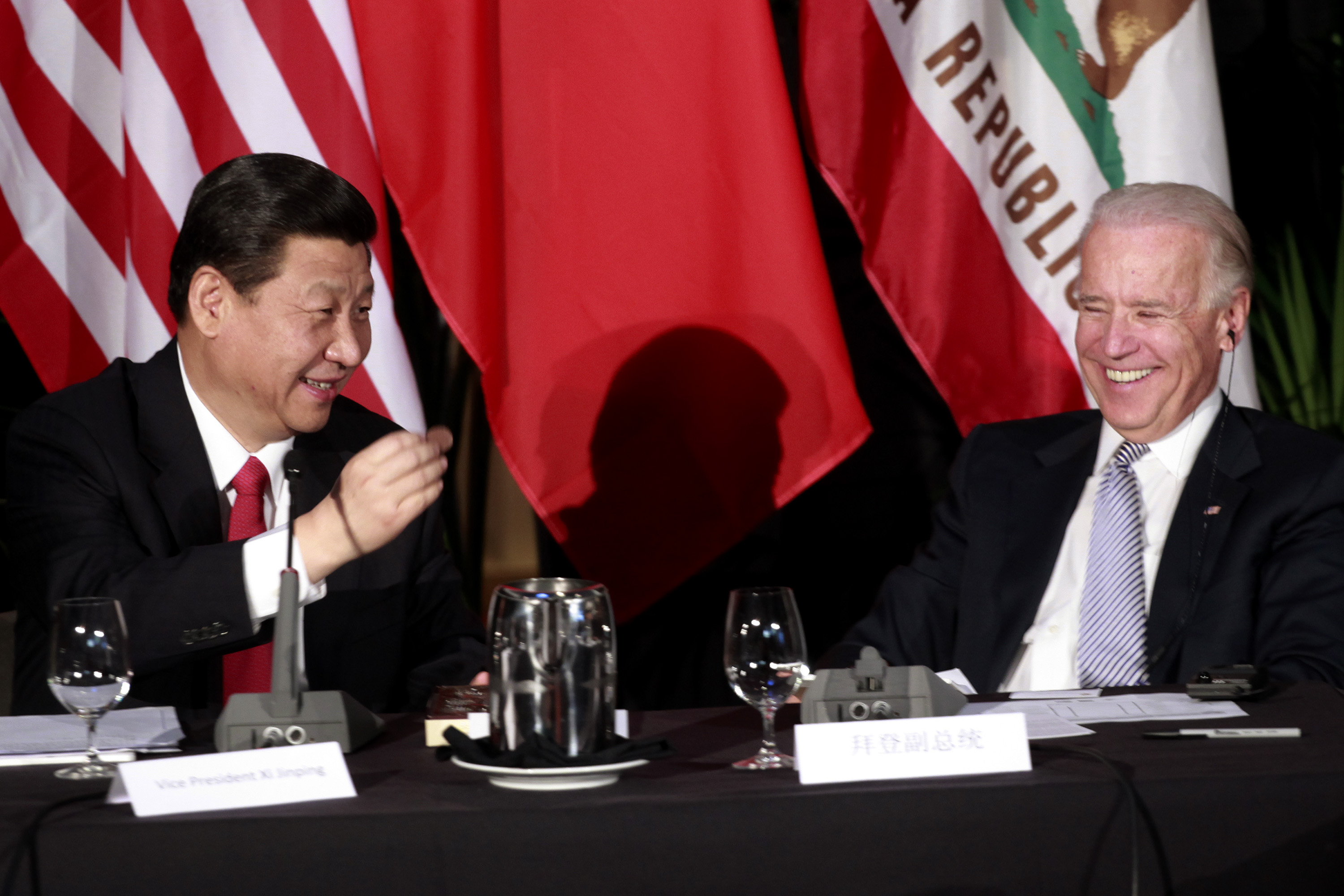 Seated at an event in 2012 when both were vice presidents, Chinese President Xi Jinping showed President Joe Biden a chocolate-covered macadamia nut while both laughed.