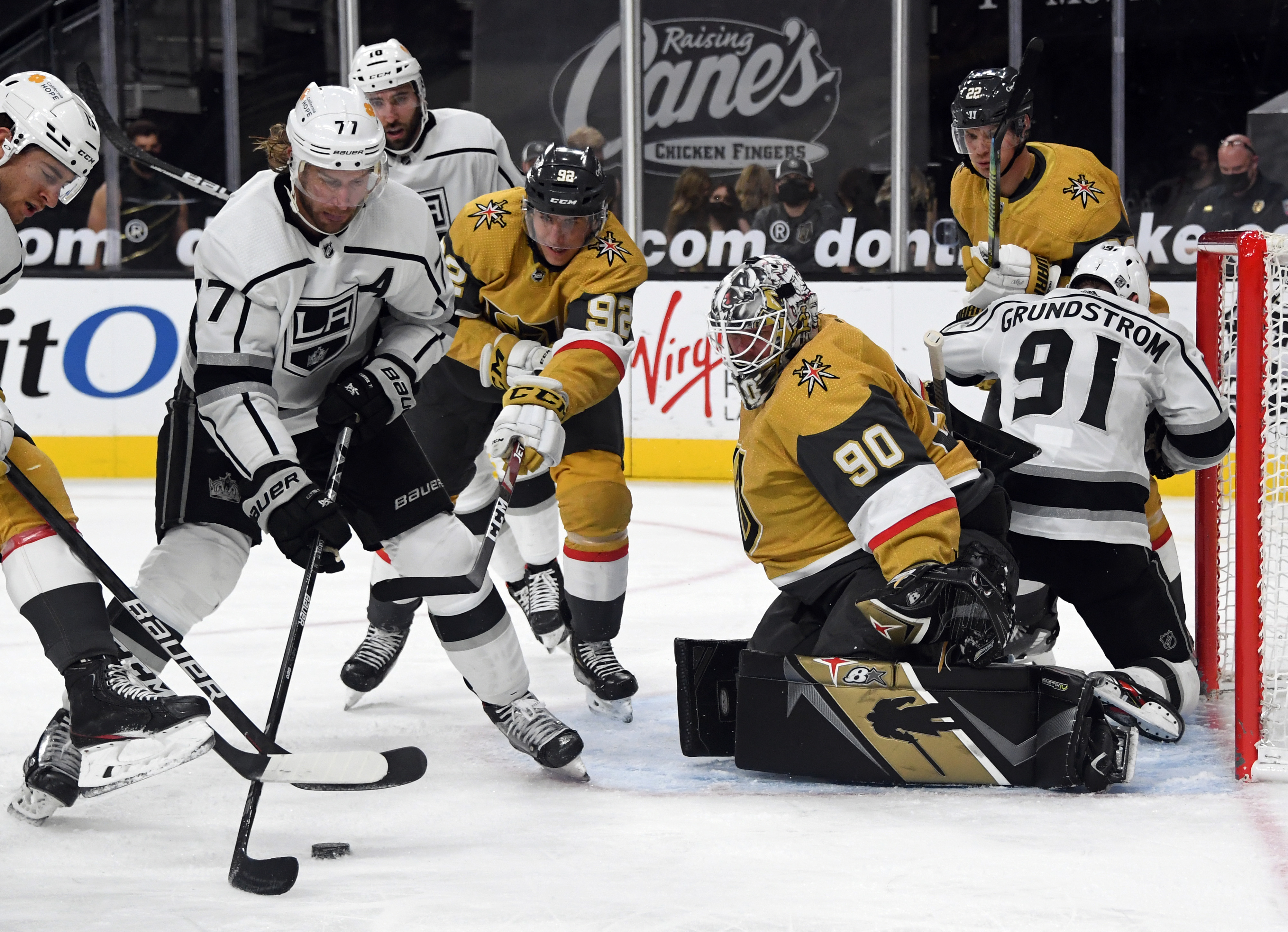 Jeff Carter #77 of the Los Angeles Kings tries to get a shot off against Tomas Nosek #92 and Robin Lehner #90 of the Vegas Golden Knights in the third period of their game at T-Mobile Arena on February 7, 2021 in Las Vegas, Nevada. The Golden Knights defeated the Kings 4-3.