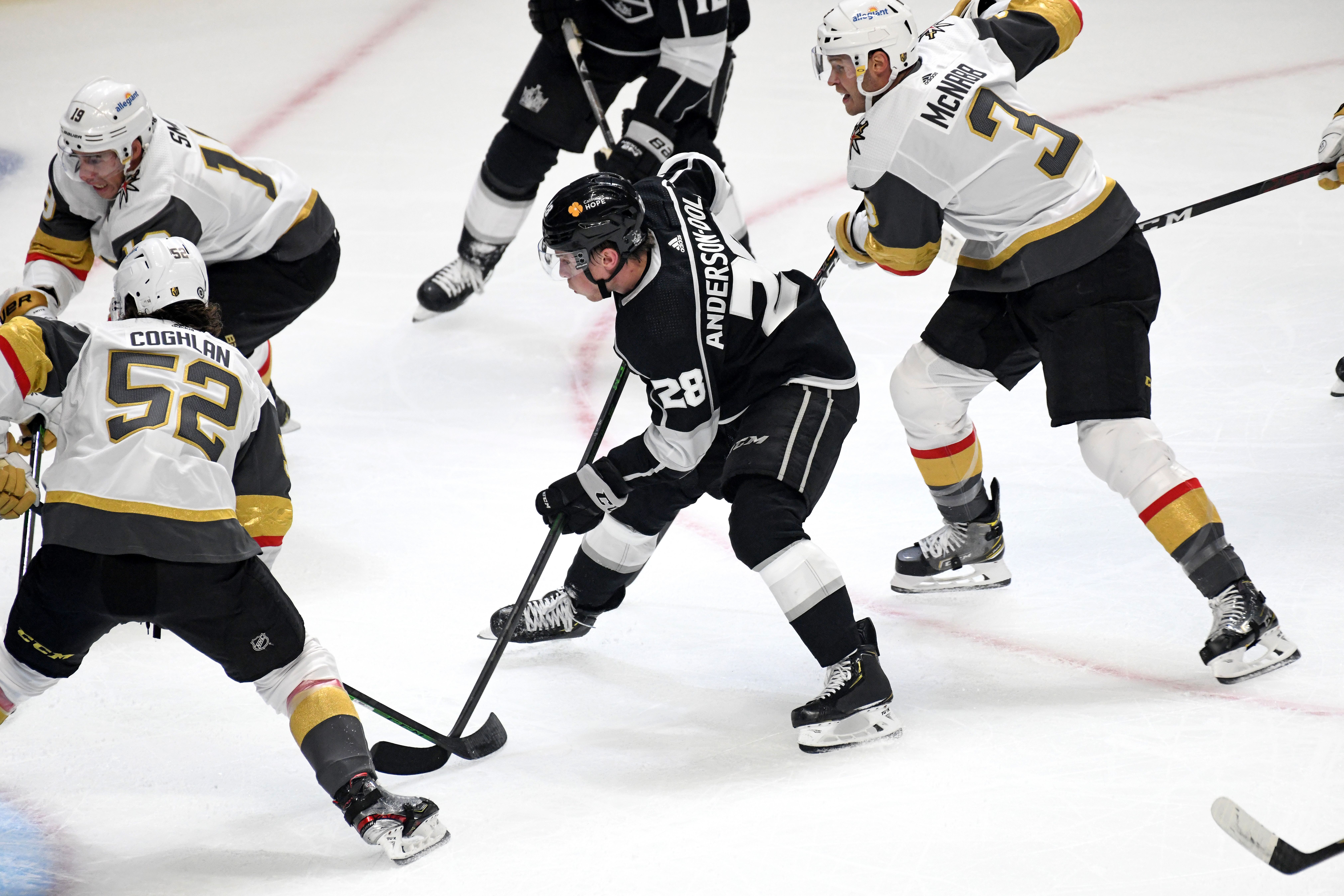 Los Angeles Kings Center Jaret Anderson-Dolan (28) takes a shot on net despite heavy defensive pressure during a National Hockey League game March 19, 2021, at the Staples Center in Los Angeles, CA.