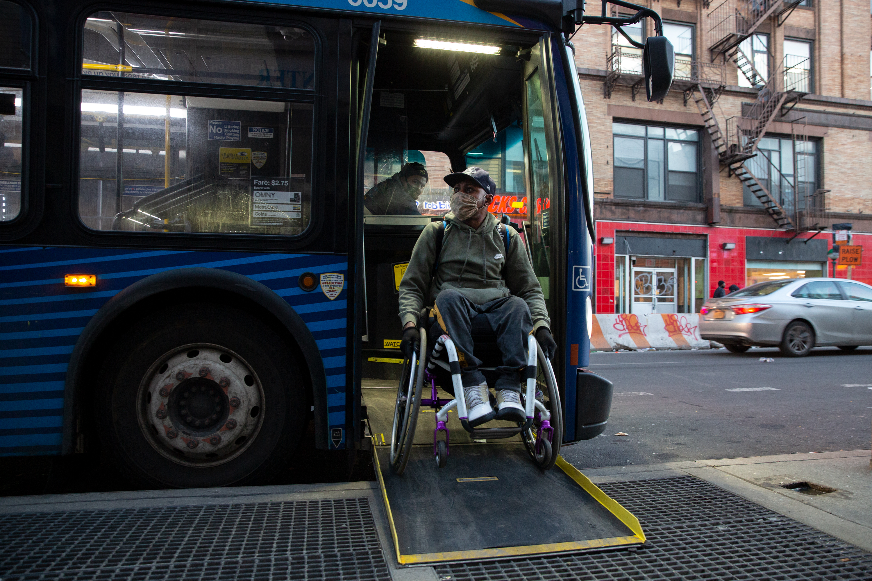 Saheed Adebayo Aare takes an M35 bus to East Harlem at the start of a three-hour commute from Wards Island to Carteret, N.J., Feb. 24, 2021.
