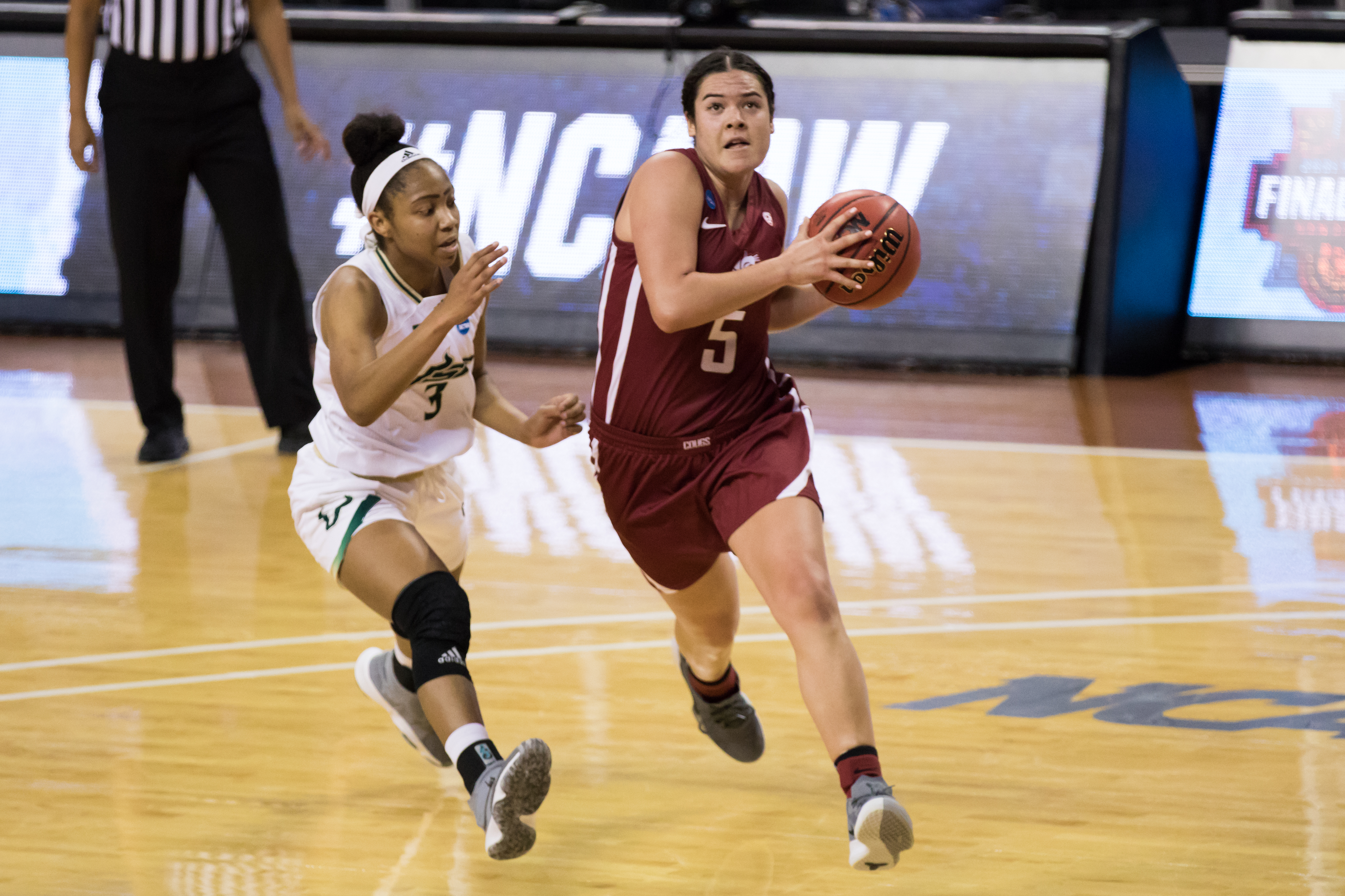 AUSTIN, TX - MARCH 21: Washington State guard Charlisse Leger-Walker (5) drives for a layup during the third quarter of the Women's NCAA Tournament First Round matchup between the USF Bulls and the Washington State Cougars on March 21, 2021, at Frank Erwin Center in Austin, TX.