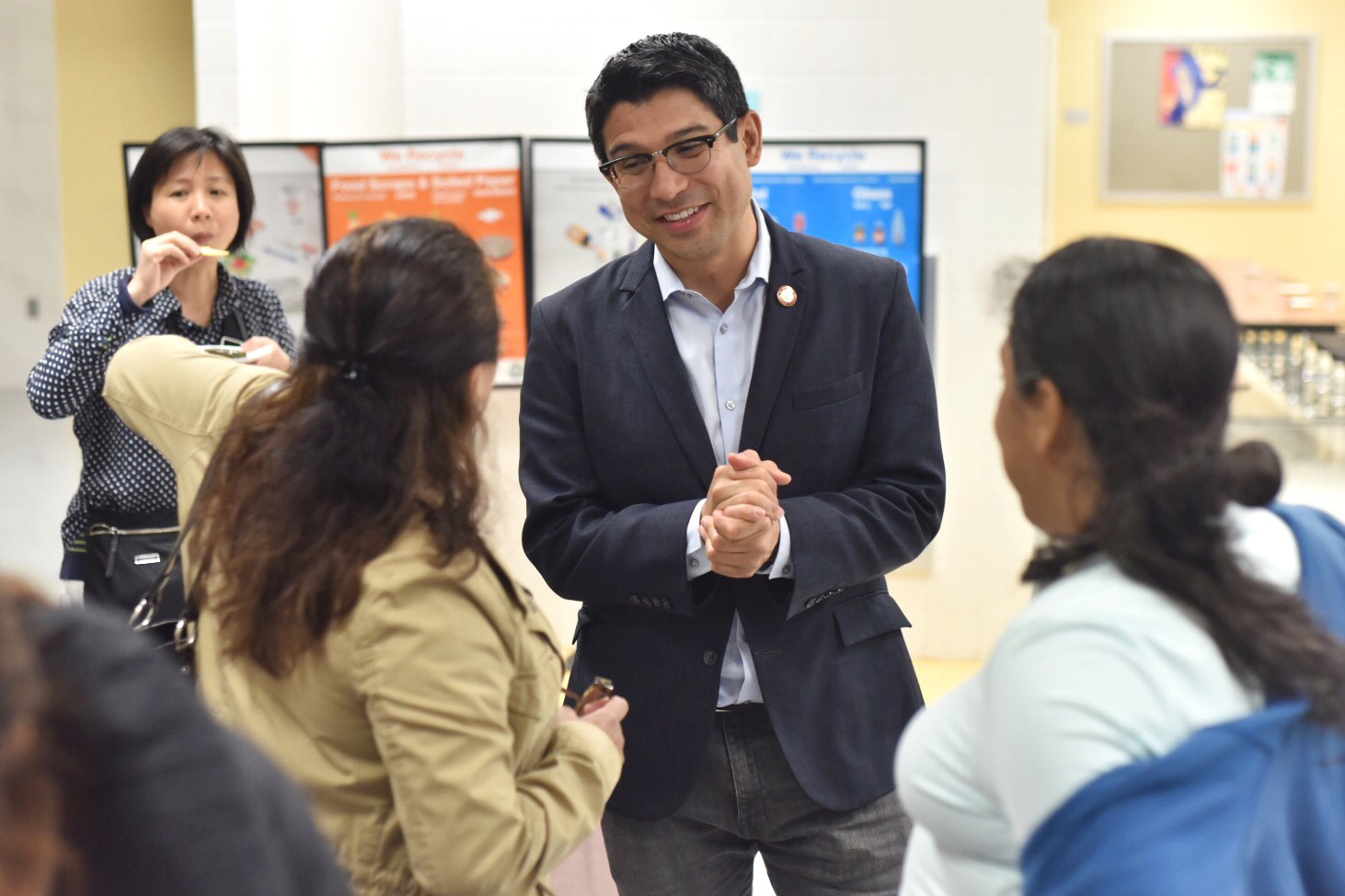 City Councilmember Carlos Menchaca speaks with voters in his Brooklyn district about participatory budgeting, May 9, 2018.