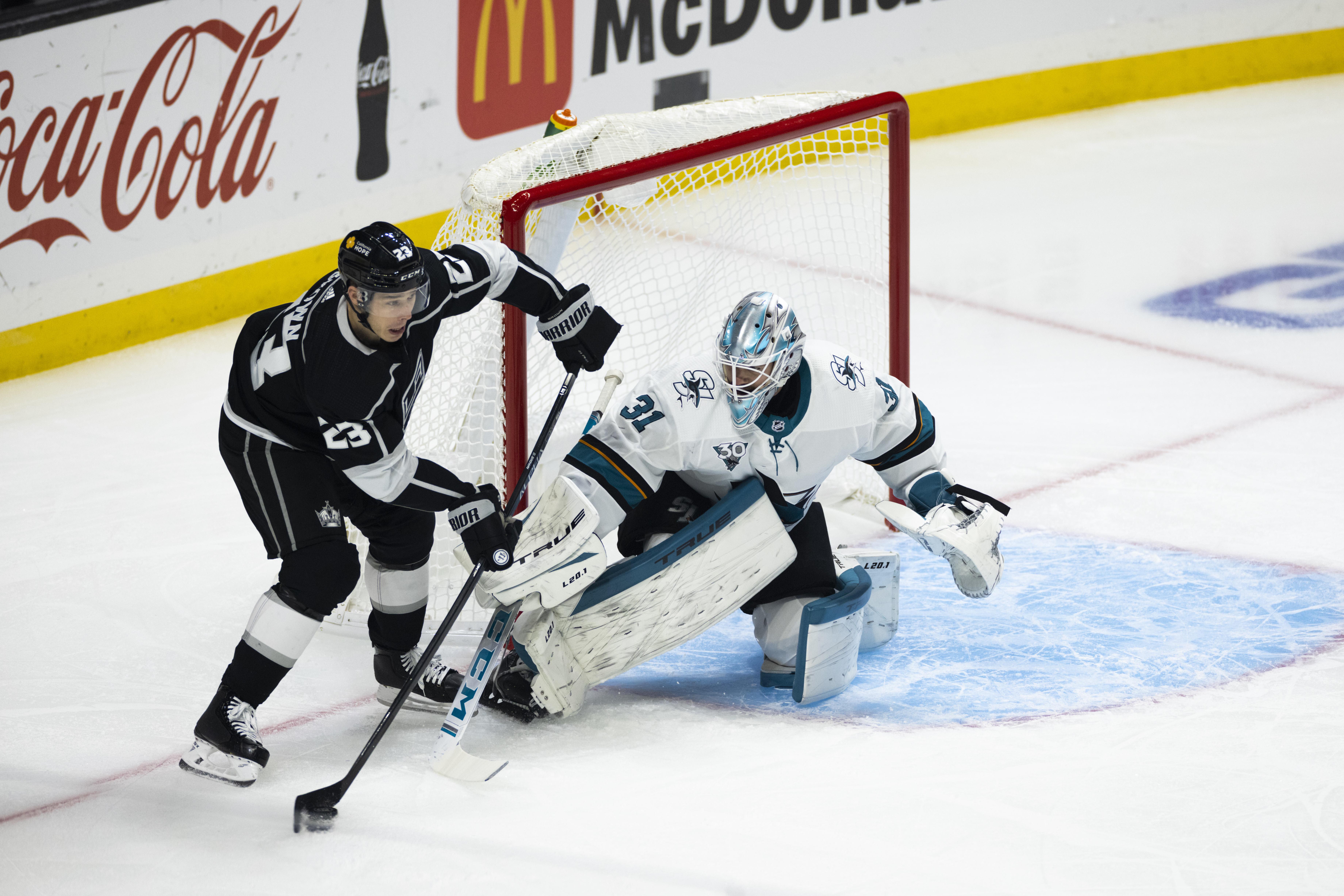 Los Angeles Kings right wing Dustin Brown (23) against San Jose Sharks goaltender Martin Jones (31) during the NHL regular season game on Thursday, February 11, 2021 at the Staples Center in Los Angeles, CA.
