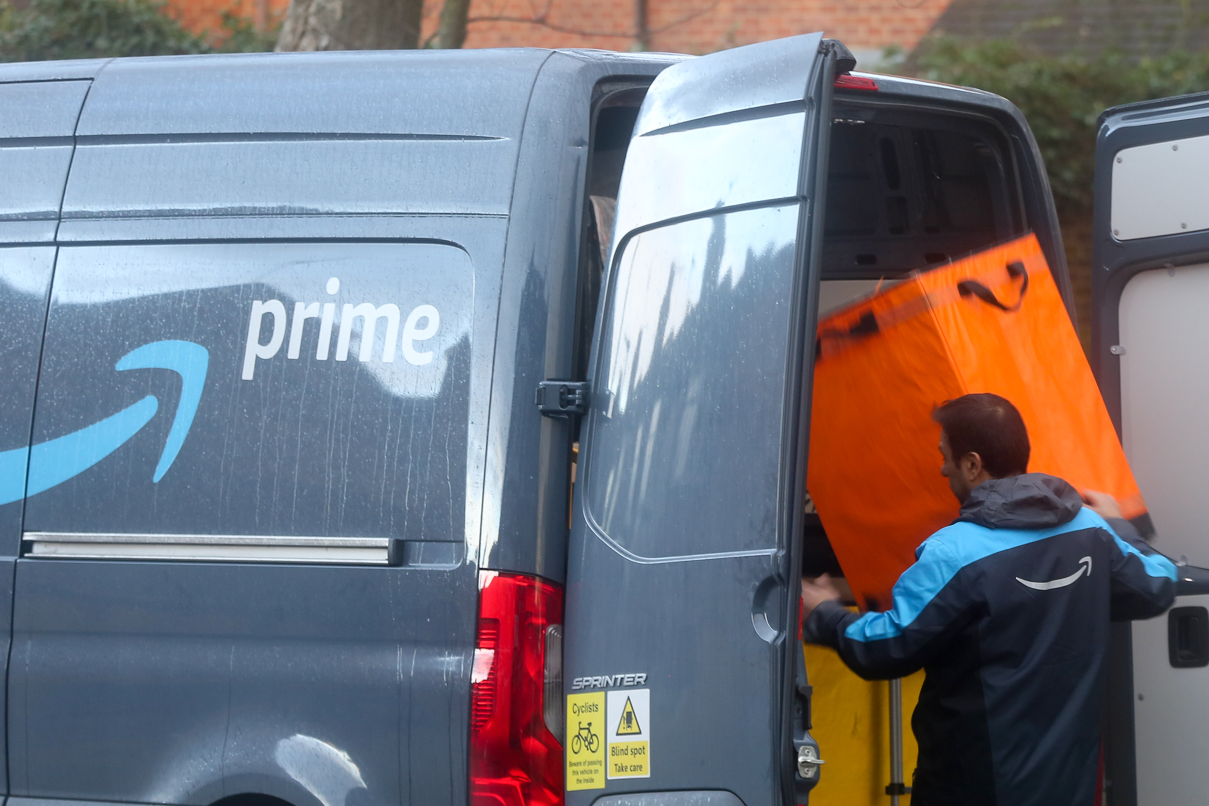 A driver of Amazon prime prepares for delivery in London...