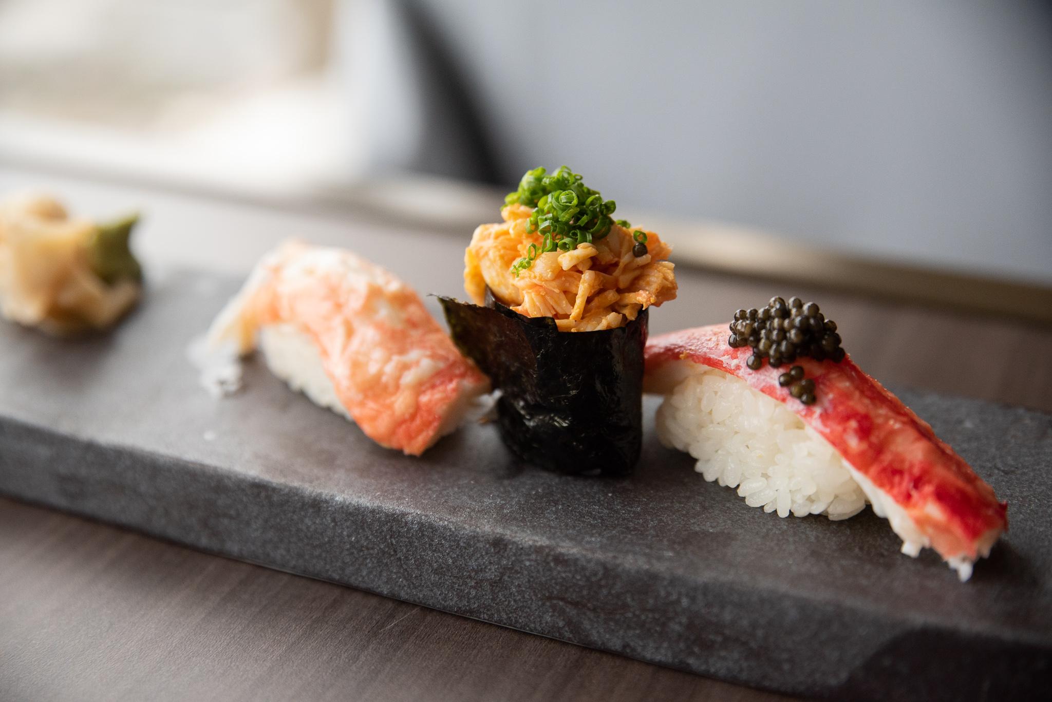 A trio of nigiri — king crab, shrimp, and uni