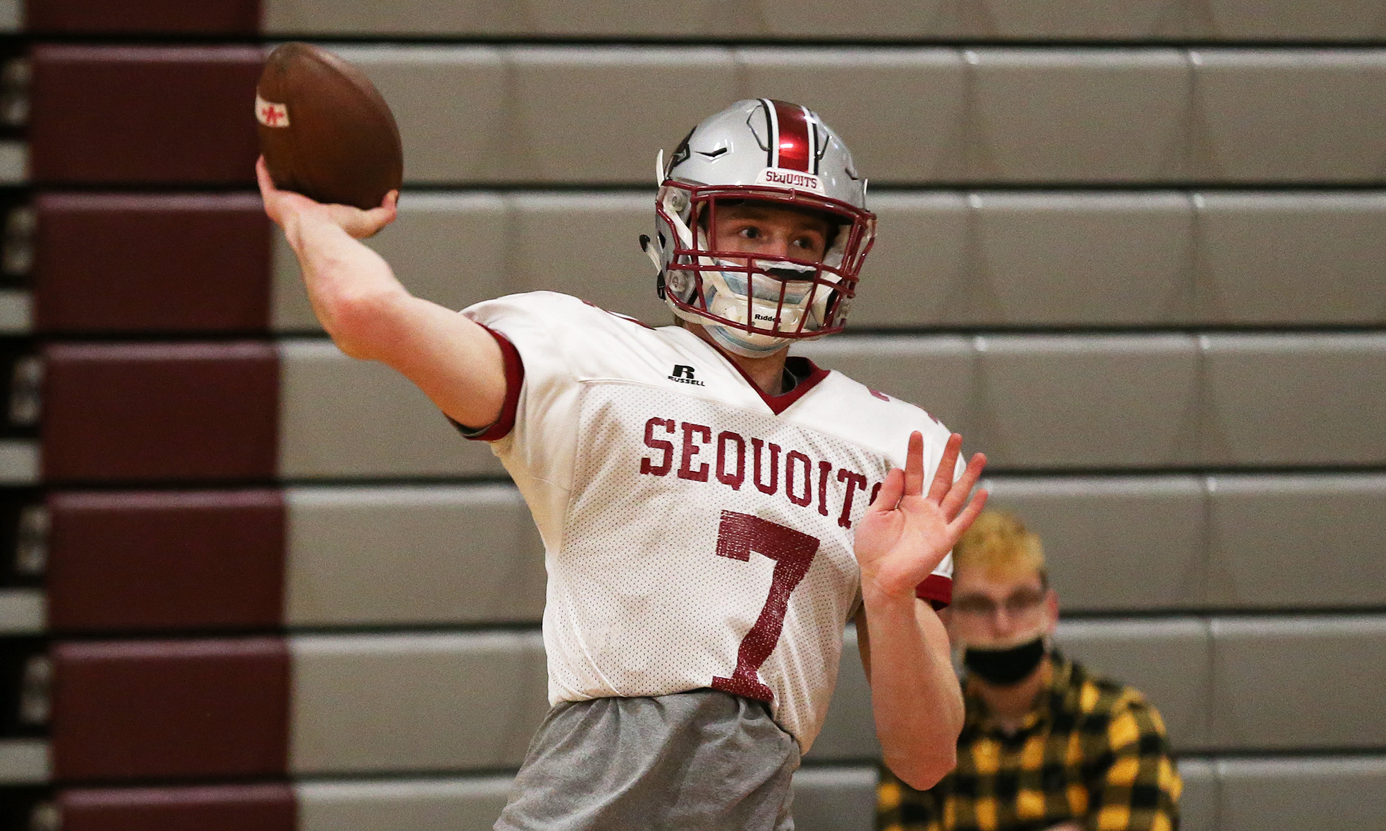 Antioch football's Athan Kaliakmanis throws a pass during a Sequoits' practice.