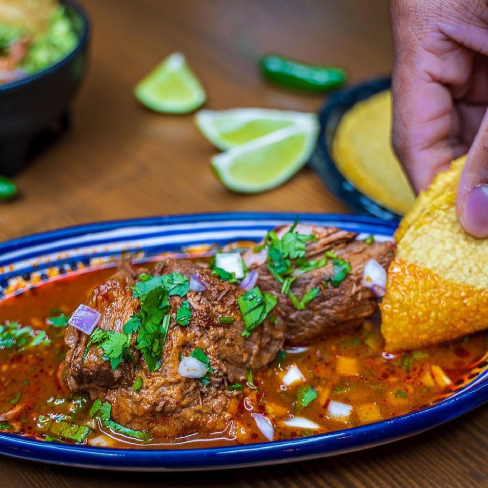A side dish of birria, spicy beef stew, on the menu at Tacos El Cabron, close to UNLV.