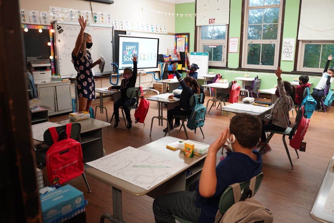 First and second graders at Harms Elementary School learn about COVID safety on the first day of classes, Sept. 8. The Detroit district announced Thursday it is suspending in-person classes until January.